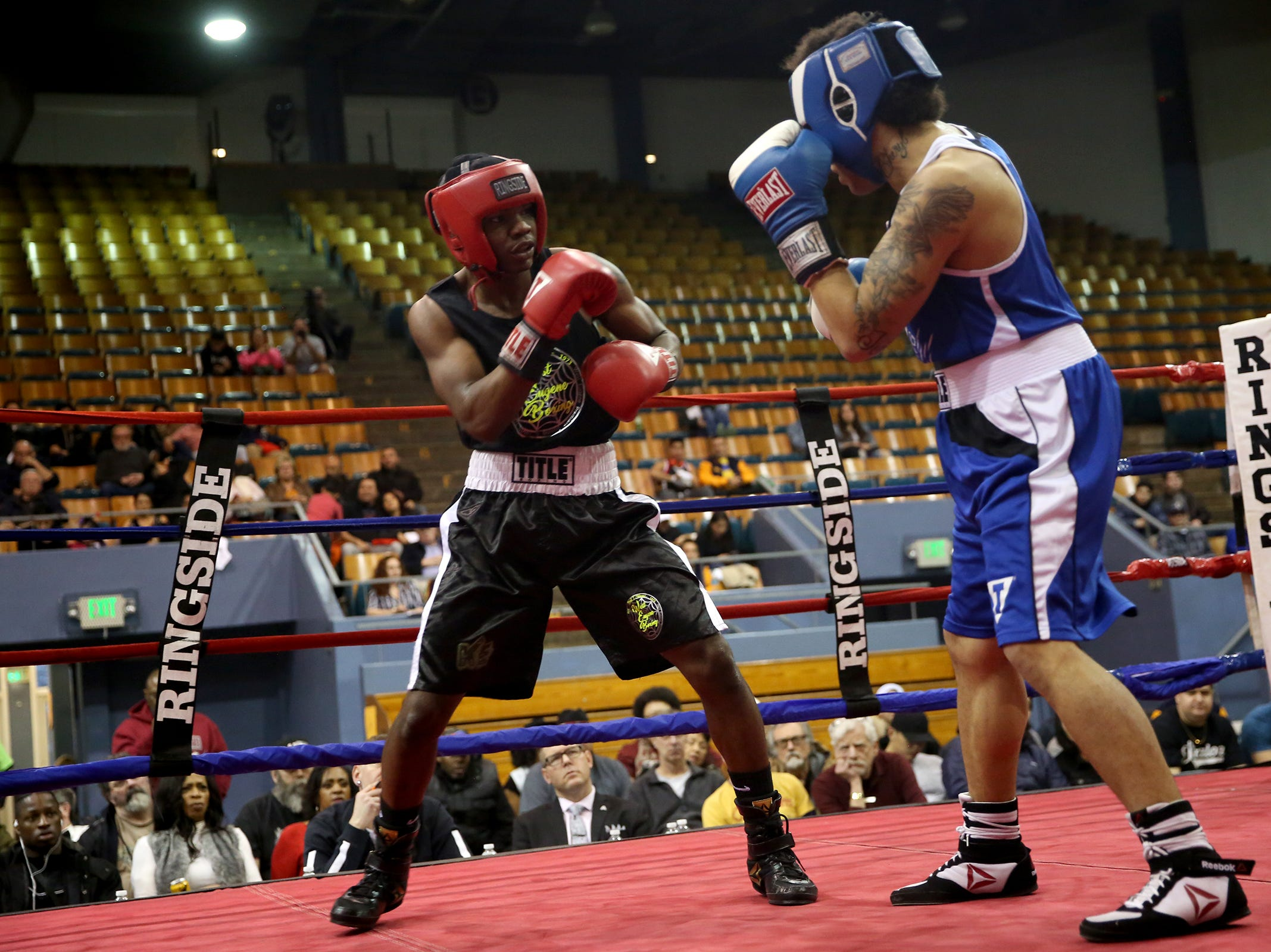 Kevin Evans of Eugene (left) takes on Gabriel Fraser of Lacy (right) during the Oregon Golden Gloves championship matches at the Salem Armory on Saturday, Feb. 2, 2019.