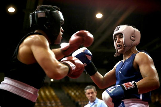 Omar Murillo of Salem takes on Eduard Yanez of Grehsam at the Oregon Golden Gloves championship matches at the Salem Armory on Saturday, Feb. 2, 2019.