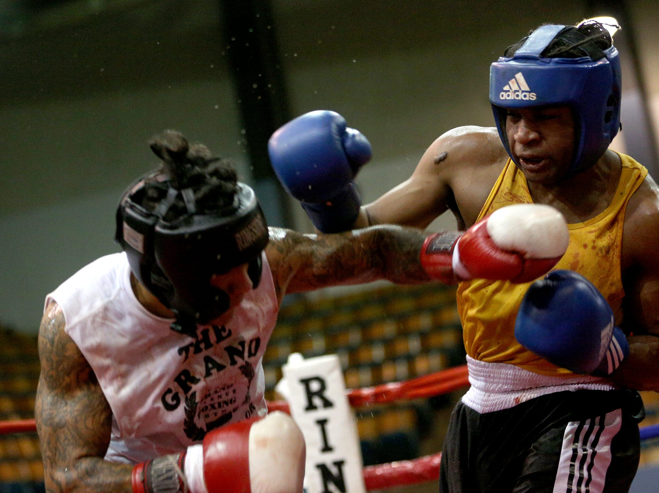 Joseph Aguilar (left) of Happy Valley takes on Terance Oddie of Vancouver at the Oregon Golden Gloves championship matches at the Salem Armory on Saturday, Feb. 2, 2019.