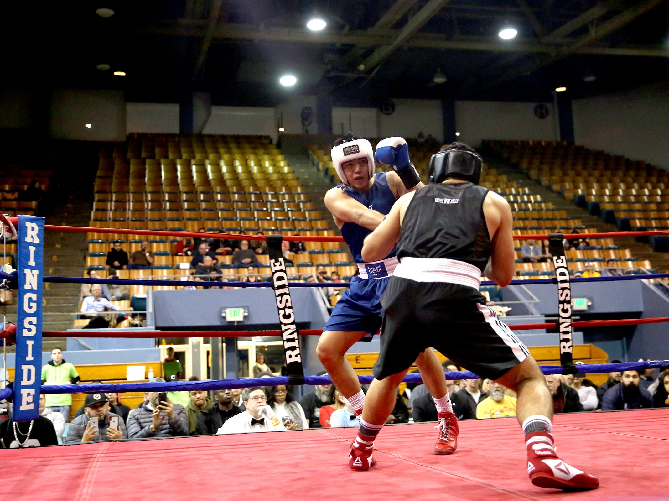 Omar Murillo of Salem takes at jab at Eduard Yanez of Grehsam at the Oregon Golden Gloves championship matches at the Salem Armory on Saturday, Feb. 2, 2019.