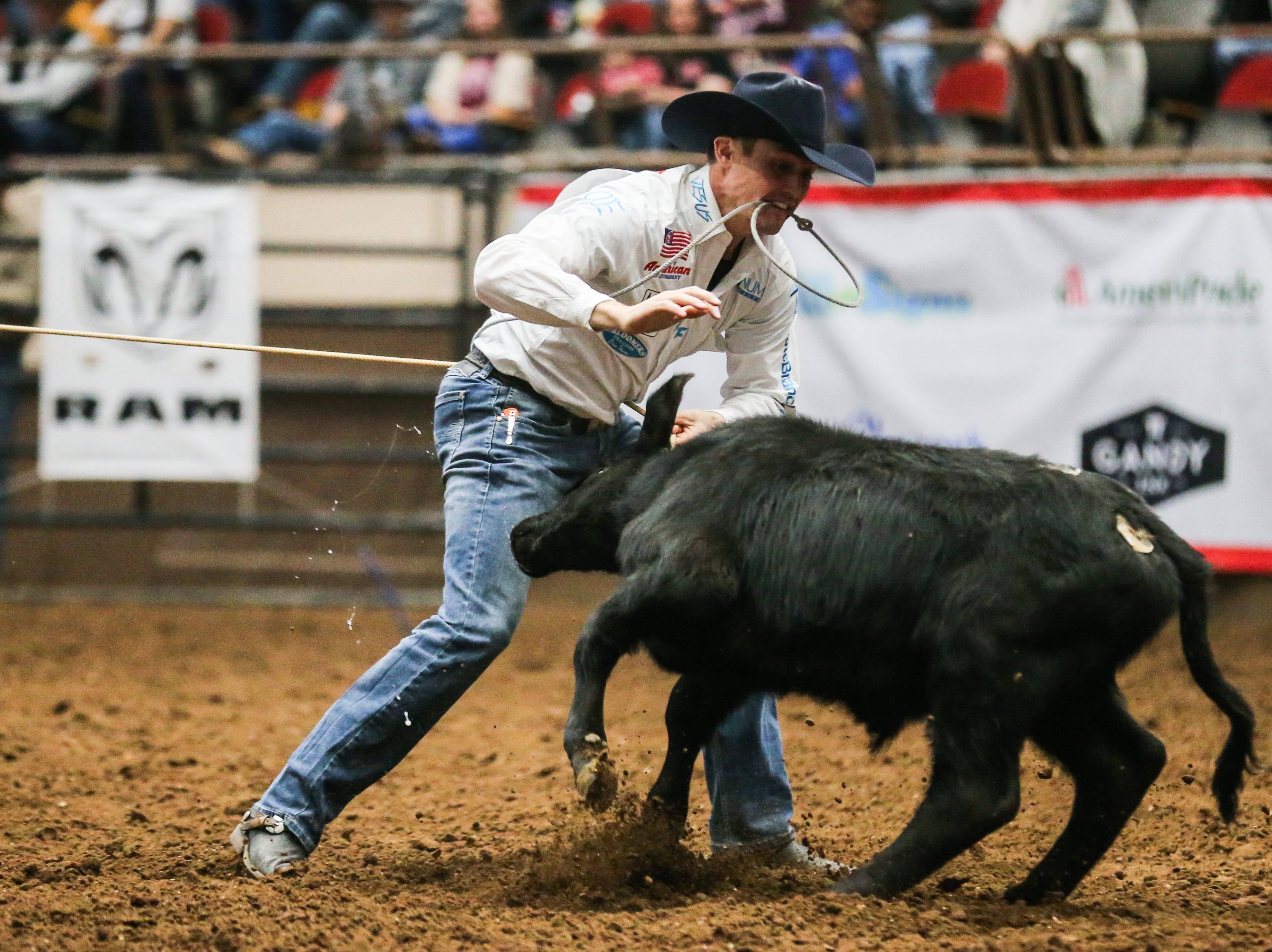Tuf Cooper runs to tie down a calf during the 4th performance of the San Angelo Stock Show & Rodeo Sunday, Feb. 3, 2019, at Foster Communications Coliseum.