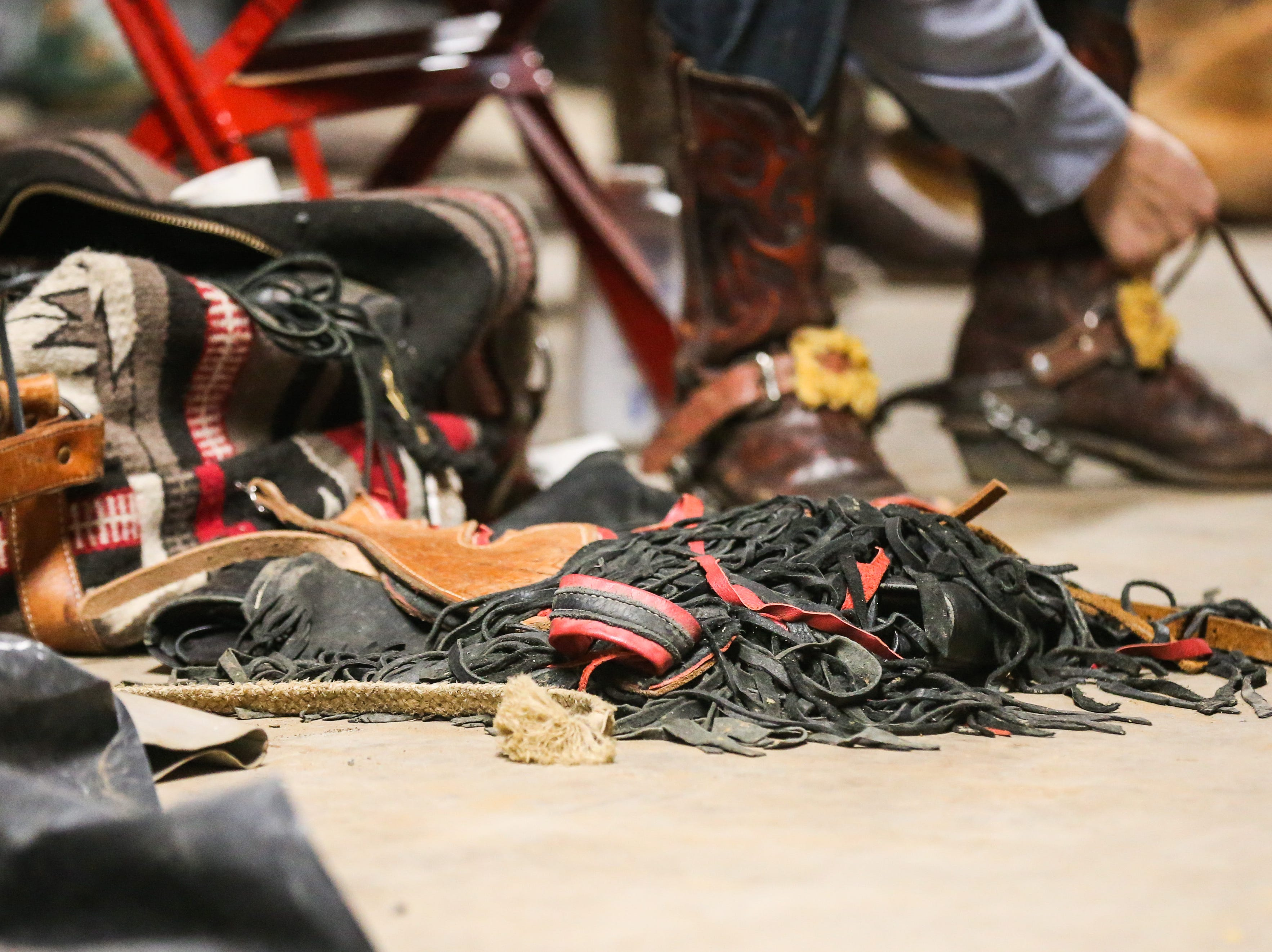 Cowboys get ready for the 3rd performance of the San Angelo Stock Show & Rodeo Saturday, Feb. 2, 2019, at Foster Communications Coliseum.