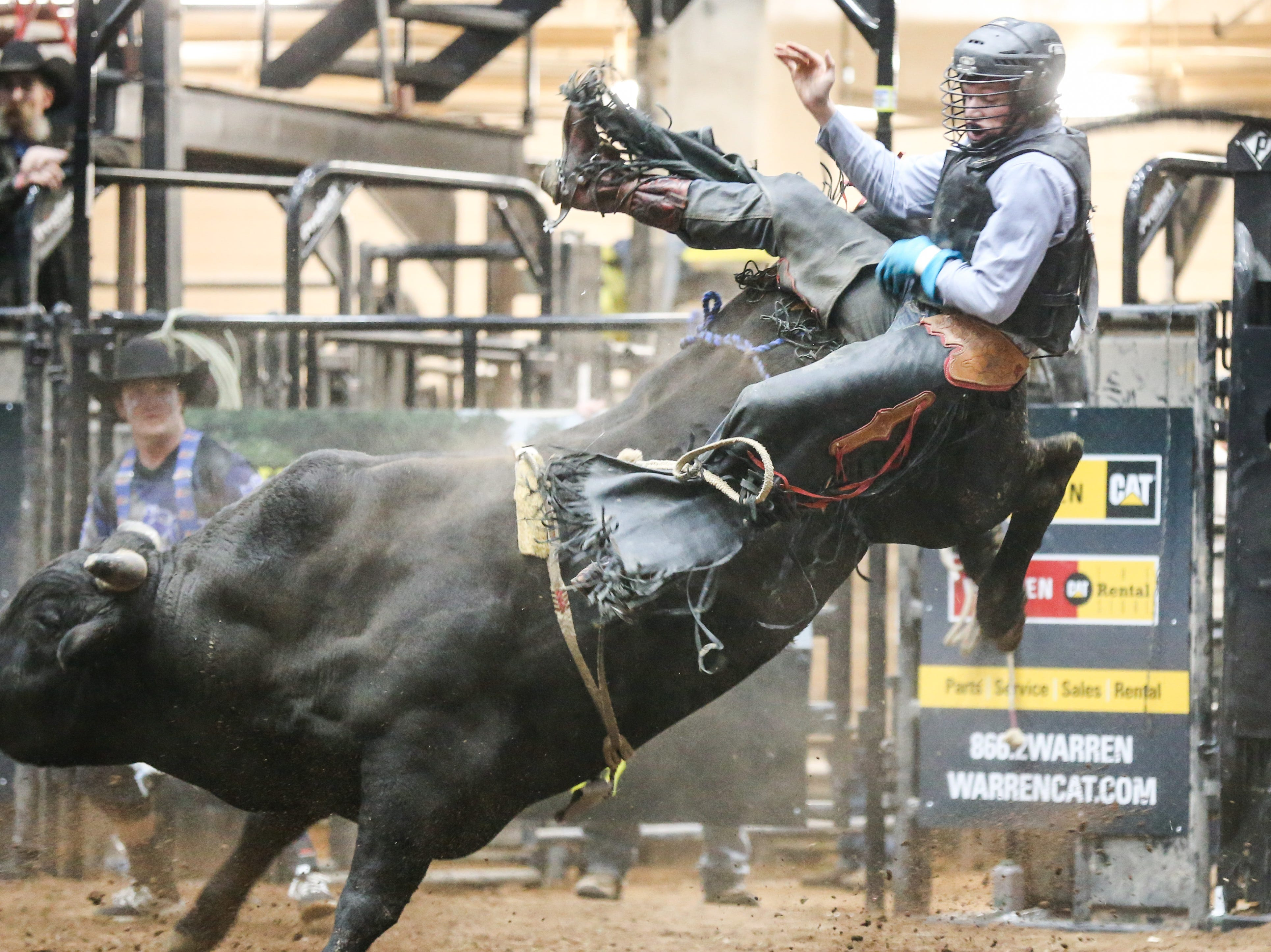 Garrett Uptain is thrown off a bull during the 3rd performance of the San Angelo Stock Show & Rodeo Saturday, Feb. 2, 2019, at Foster Communications Coliseum.