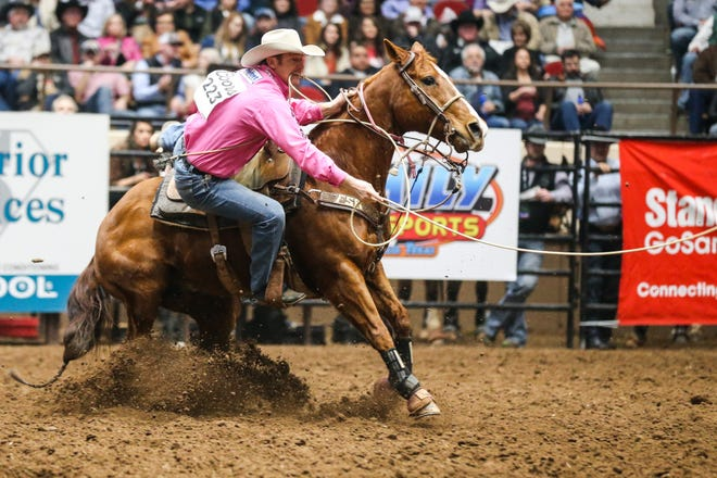Tyson Durfey rides out to tie down a calf during the 3rd performance of the San Angelo Stock Show & Rodeo Saturday, Feb. 2, 2019, at Foster Communications Coliseum.