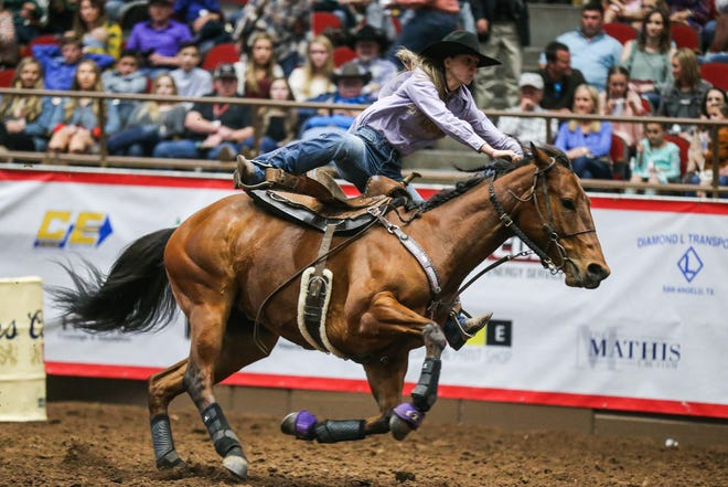 Nicole Love races around the barrels during the 4th performance of the San Angelo Stock Show & Rodeo Sunday, Feb. 3, 2019, at Foster Communications Coliseum.