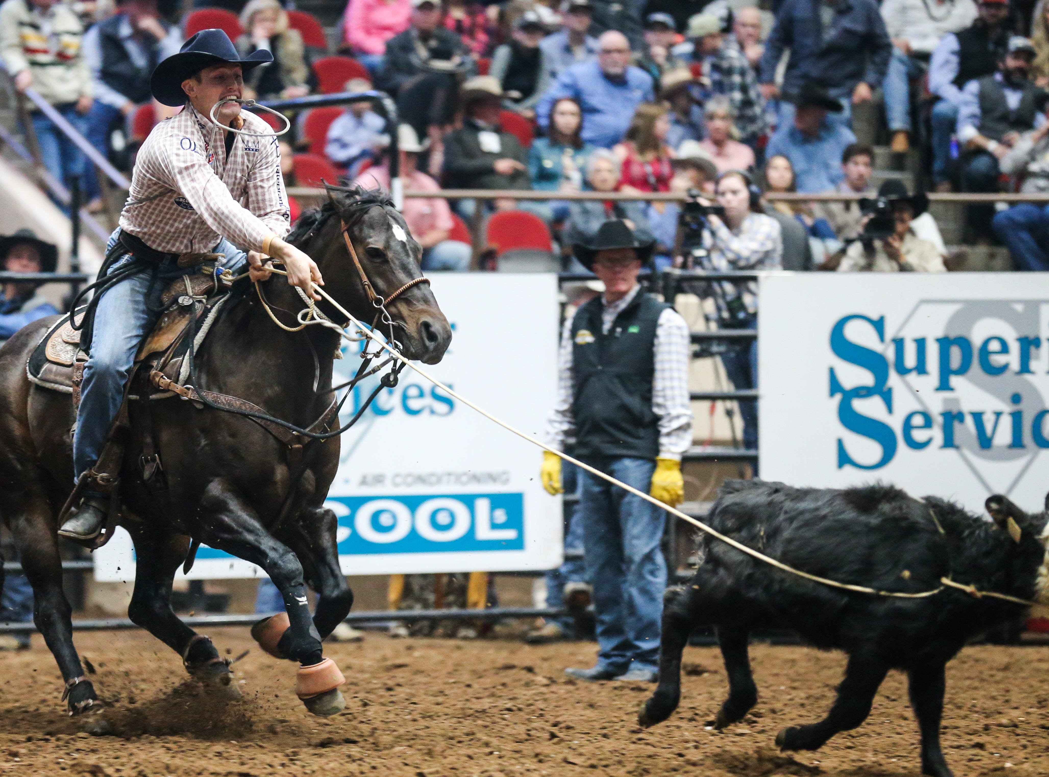Tuff Cooper rides out to tie down a calf during the 3rd performance of the San Angelo Stock Show & Rodeo Saturday, Feb. 2, 2019, at Foster Communications Coliseum.