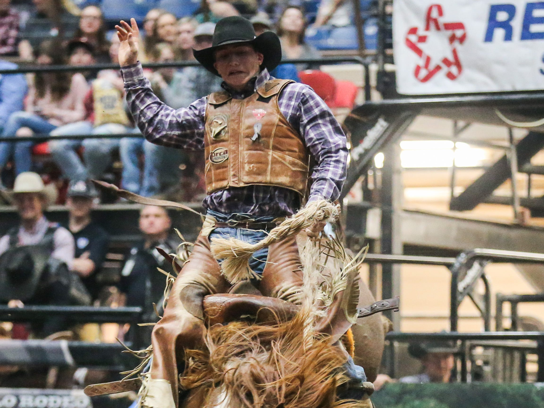 Tegan Smith rides a bronc during the 4th performance of the San Angelo Stock Show & Rodeo Sunday, Feb. 3, 2019, at Foster Communications Coliseum.