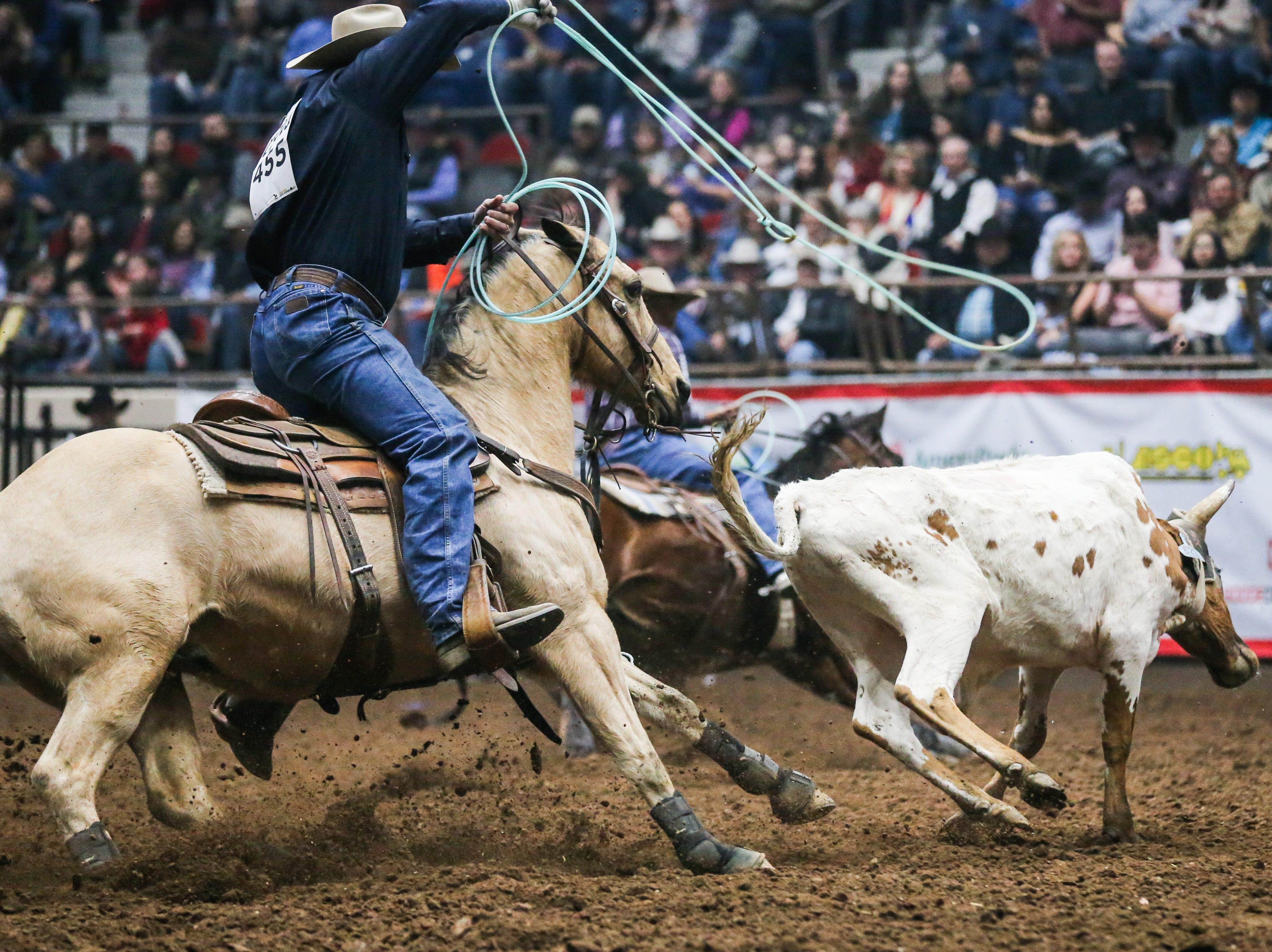 Aaron Tsinigine and Kyle Lockett team rope during the 3rd performance of the San Angelo Stock Show & Rodeo Saturday, Feb. 2, 2019, at Foster Communications Coliseum.