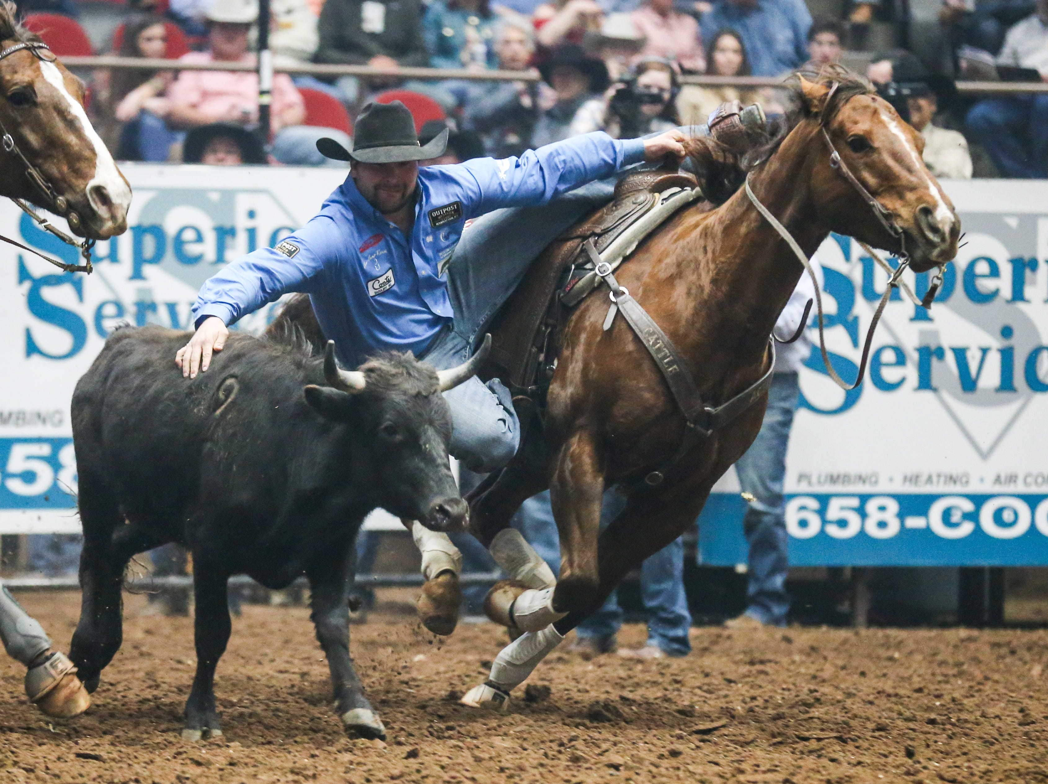 Tanner Brunner rides out to steer wrestle during the 3rd performance of the San Angelo Stock Show & Rodeo Saturday, Feb. 2, 2019, at Foster Communications Coliseum.