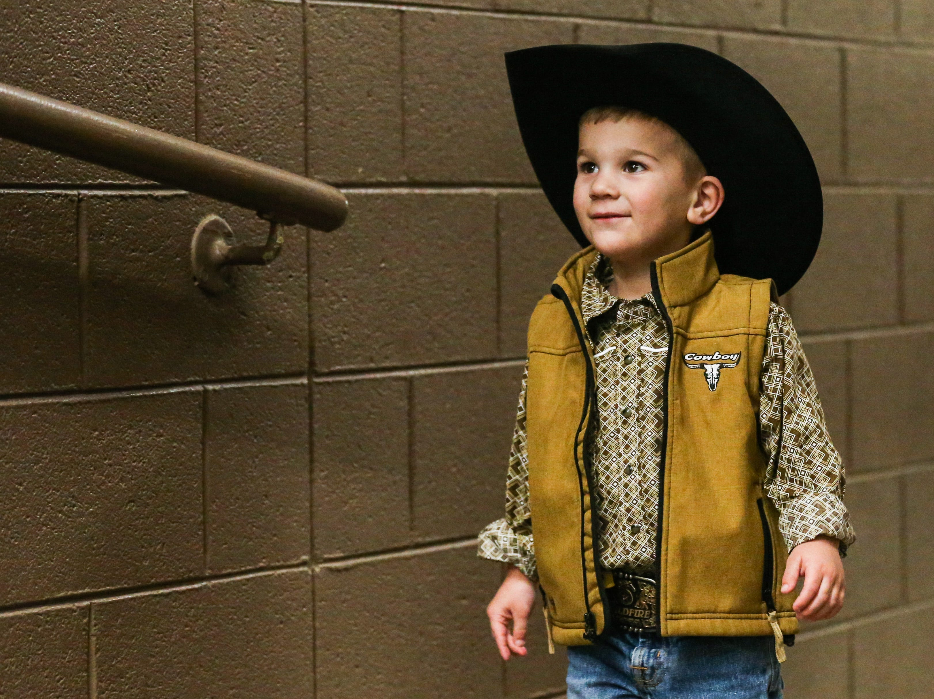 Gus Hogg, 3, looks expectedly at the ramp up to the arena before the 3rd performance of the San Angelo Stock Show & Rodeo Saturday, Feb. 2, 2019, at Foster Communications Coliseum.