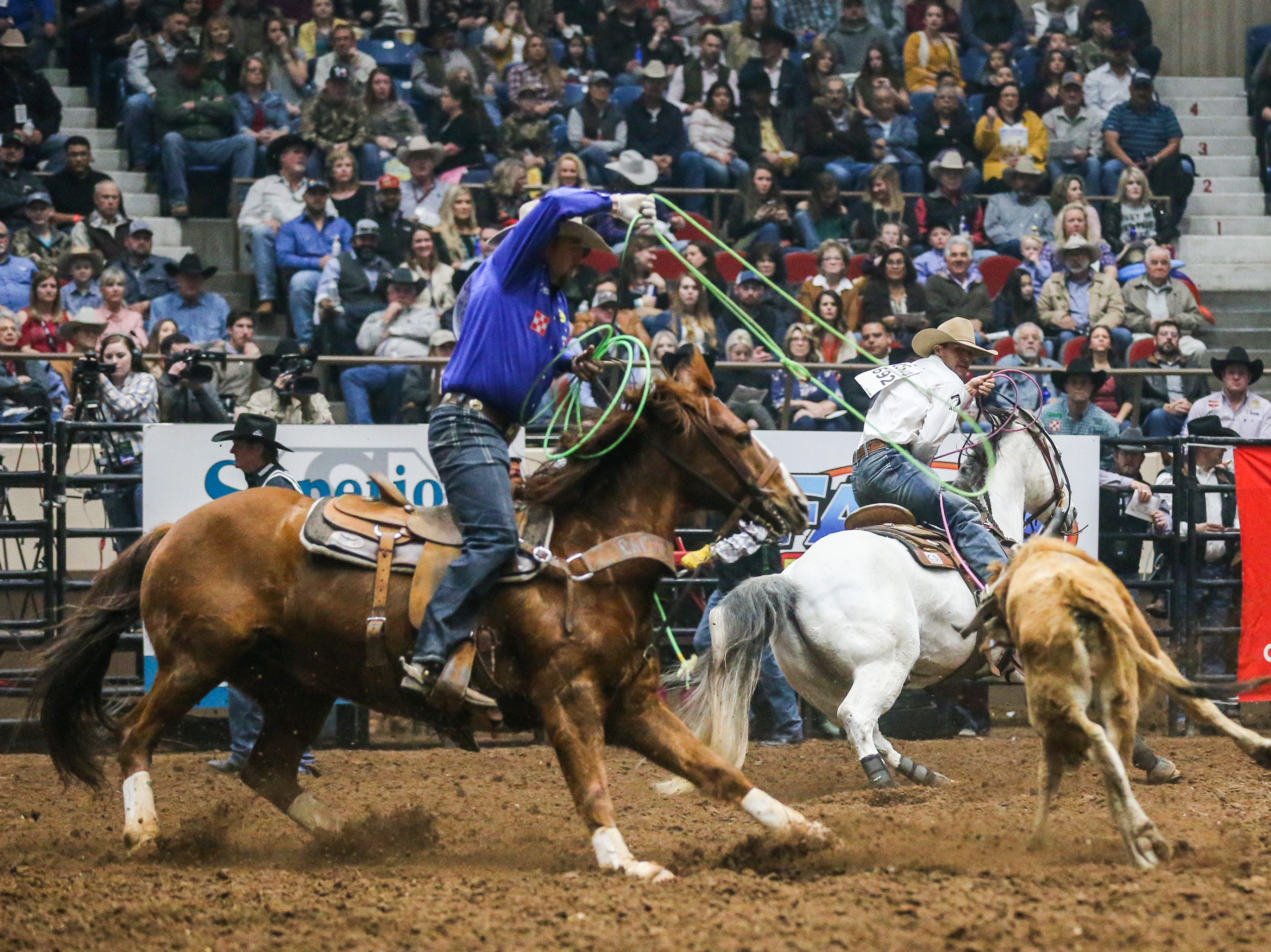Clay Smith rides with Jake Long in team roping during the 3rd performance of the San Angelo Stock Show & Rodeo Saturday, Feb. 2, 2019, at Foster Communications Coliseum.
