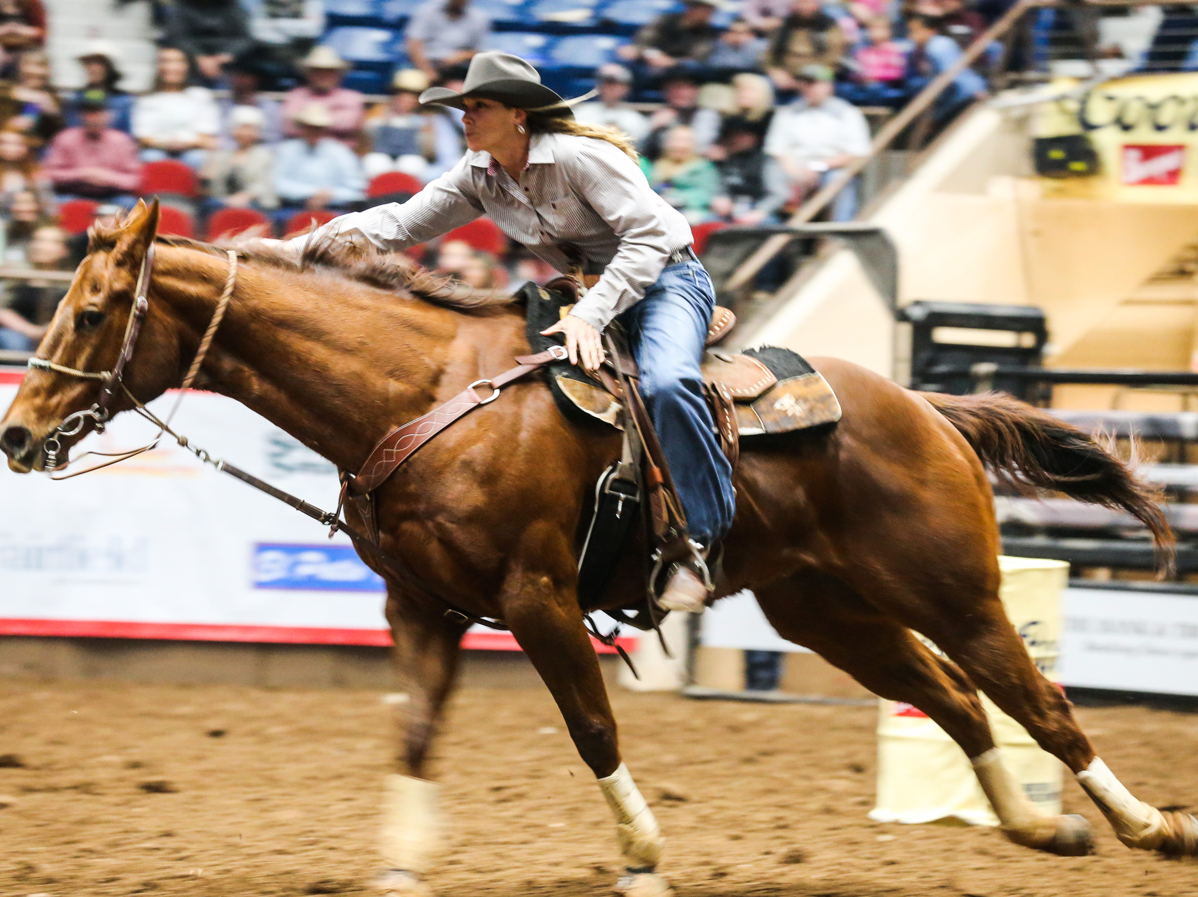 Reiney Lukas races barrels during the 3rd performance of the San Angelo Stock Show & Rodeo Saturday, Feb. 2, 2019, at Foster Communications Coliseum.