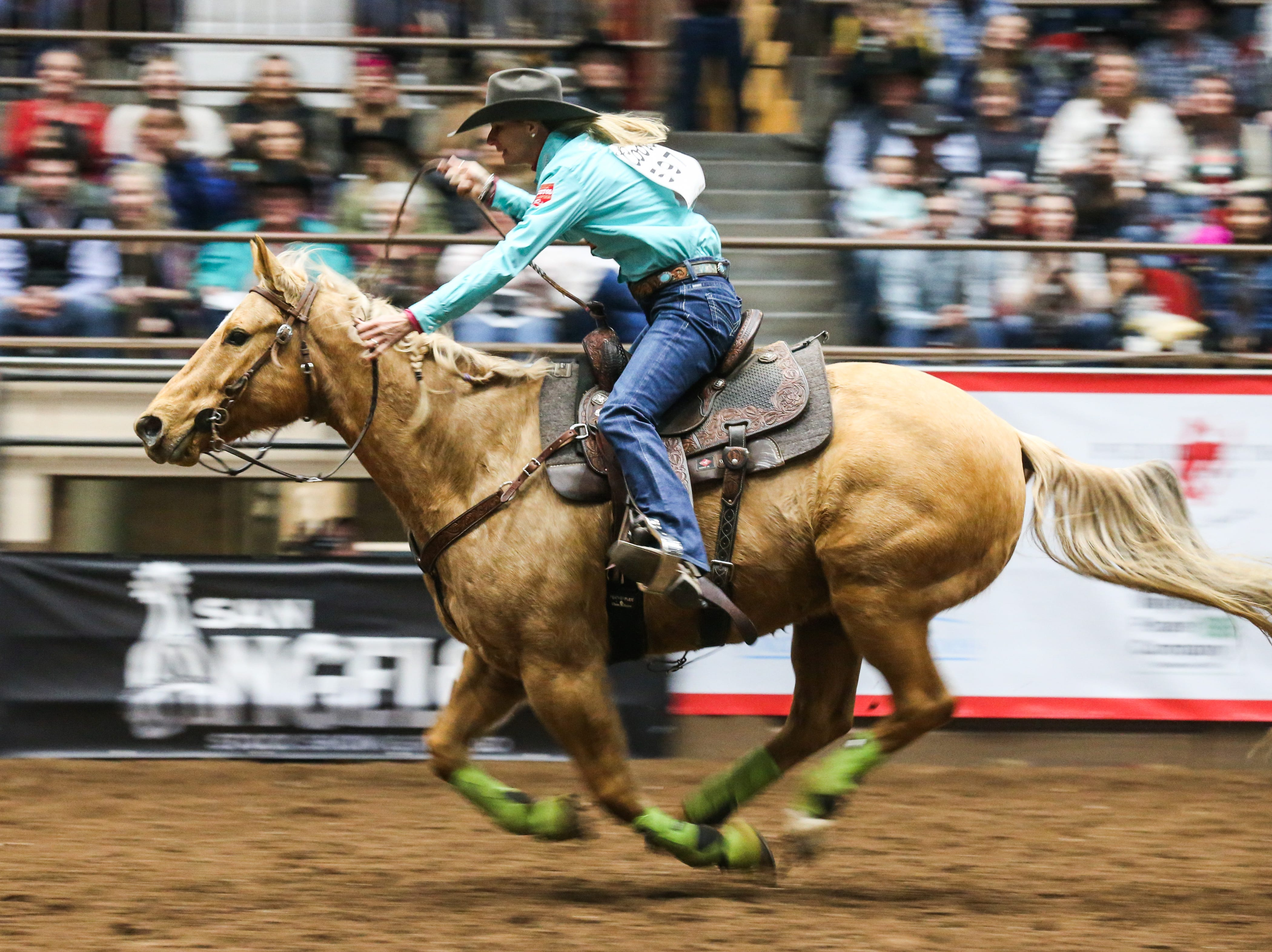 Sherry Cervi races barrels during the 3rd performance of the San Angelo Stock Show & Rodeo Saturday, Feb. 2, 2019, at Foster Communications Coliseum.