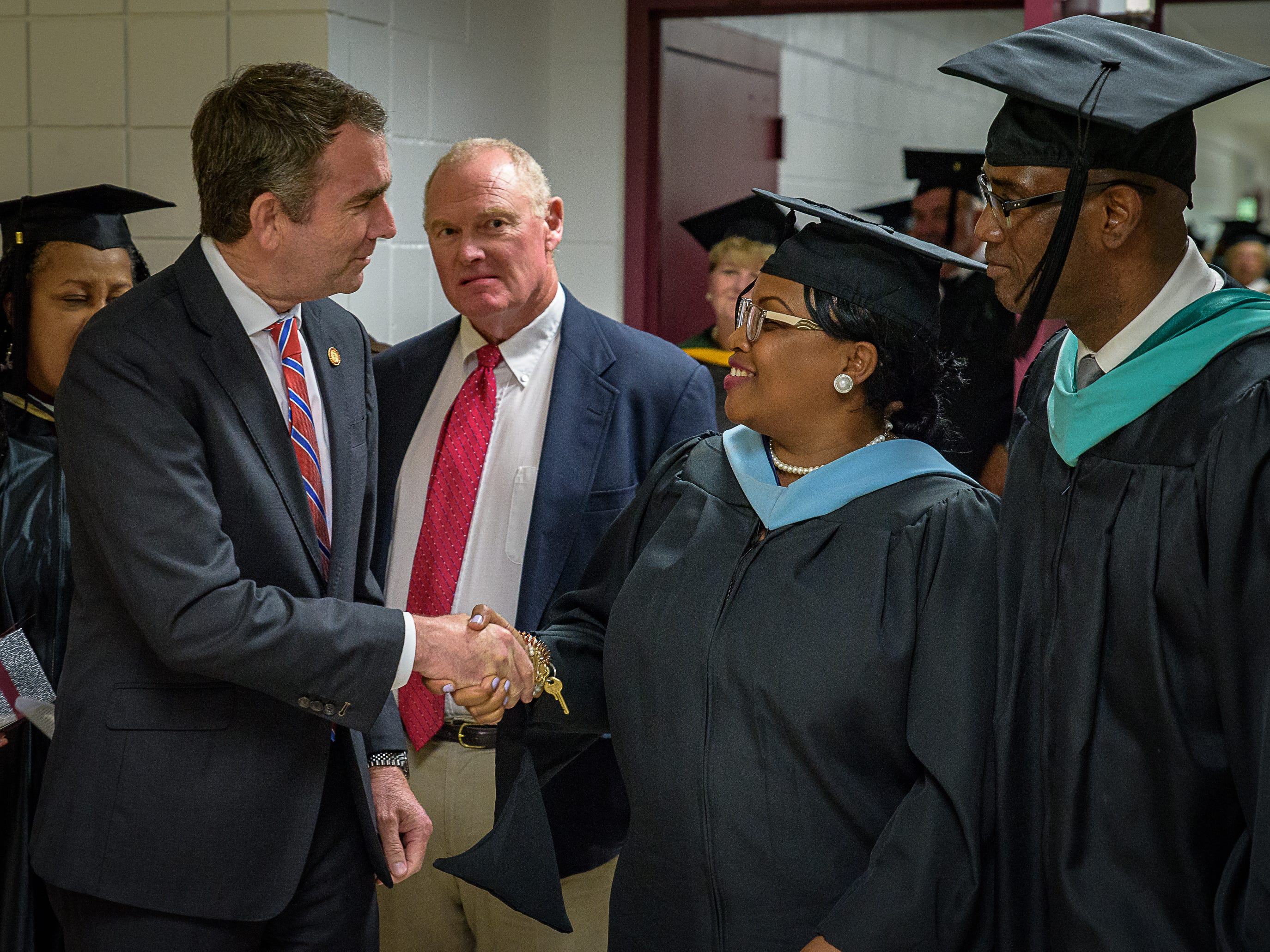 Governor Northam meets members of Nandua HIgh School's faculty before a graduation ceremony.