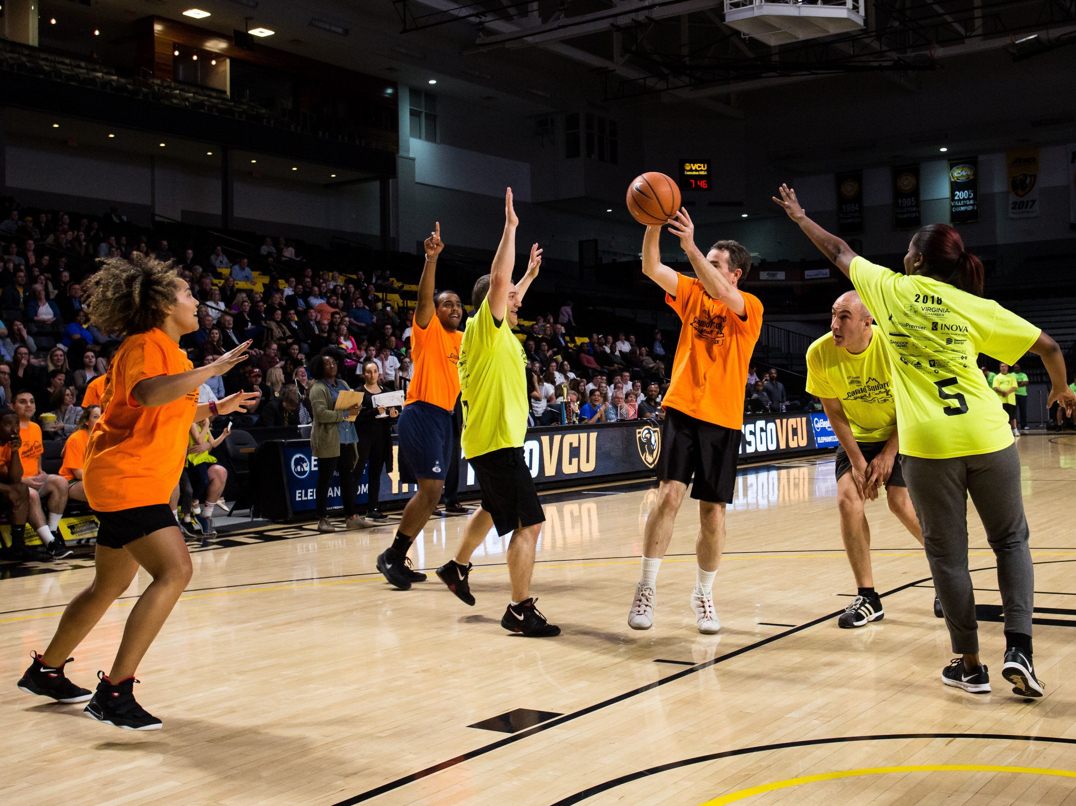 Gov. Ralph Northam in action during annual Massey Capitol Classic Challenge basketball game in Richmond, Virginia.
