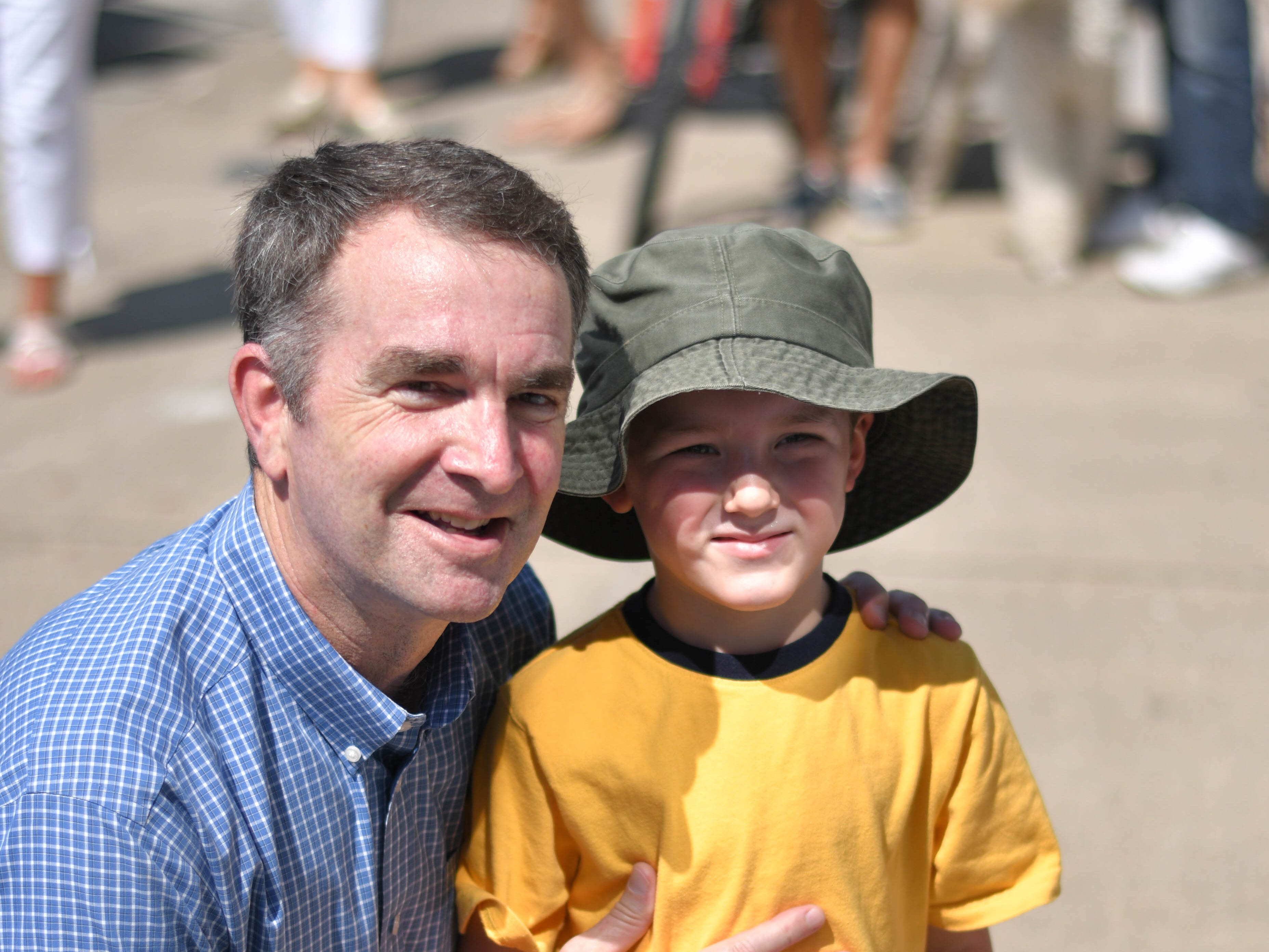 Governor Ralph Northam poses with a young bystander on Friday, July 27, 2018.