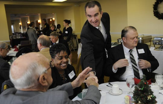 Lt. Gov.-elect Ralph Northam shakes hands with Accomack Supervisor Jack Gray before the start of the Eastern Shore Chamber of Commerce's annual Eggs and Issues breakfast on Thursday, Dec. 12, 2013.