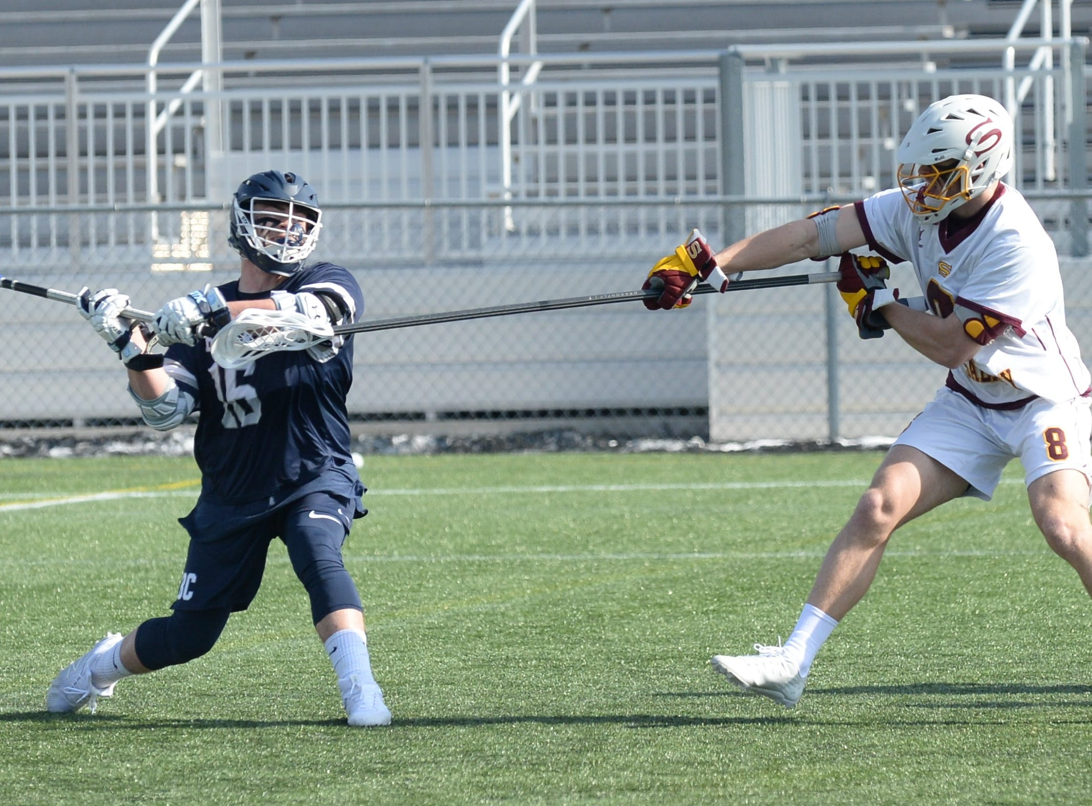Berry College's Luke Koferl takes a shot with Salisbury University's Matt O'Callaghan defending on Sunday, Feb. 3, 2019.