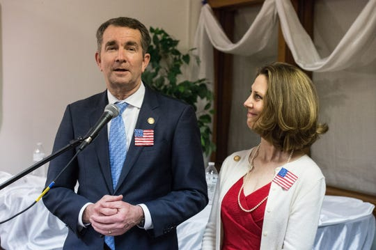 Virginia Gov. Ralph Northam speaks to his supporters with his wife, Pamela, during a fundraising gala at the Historic Onancock School on Saturday, Feb. 3, 2018.