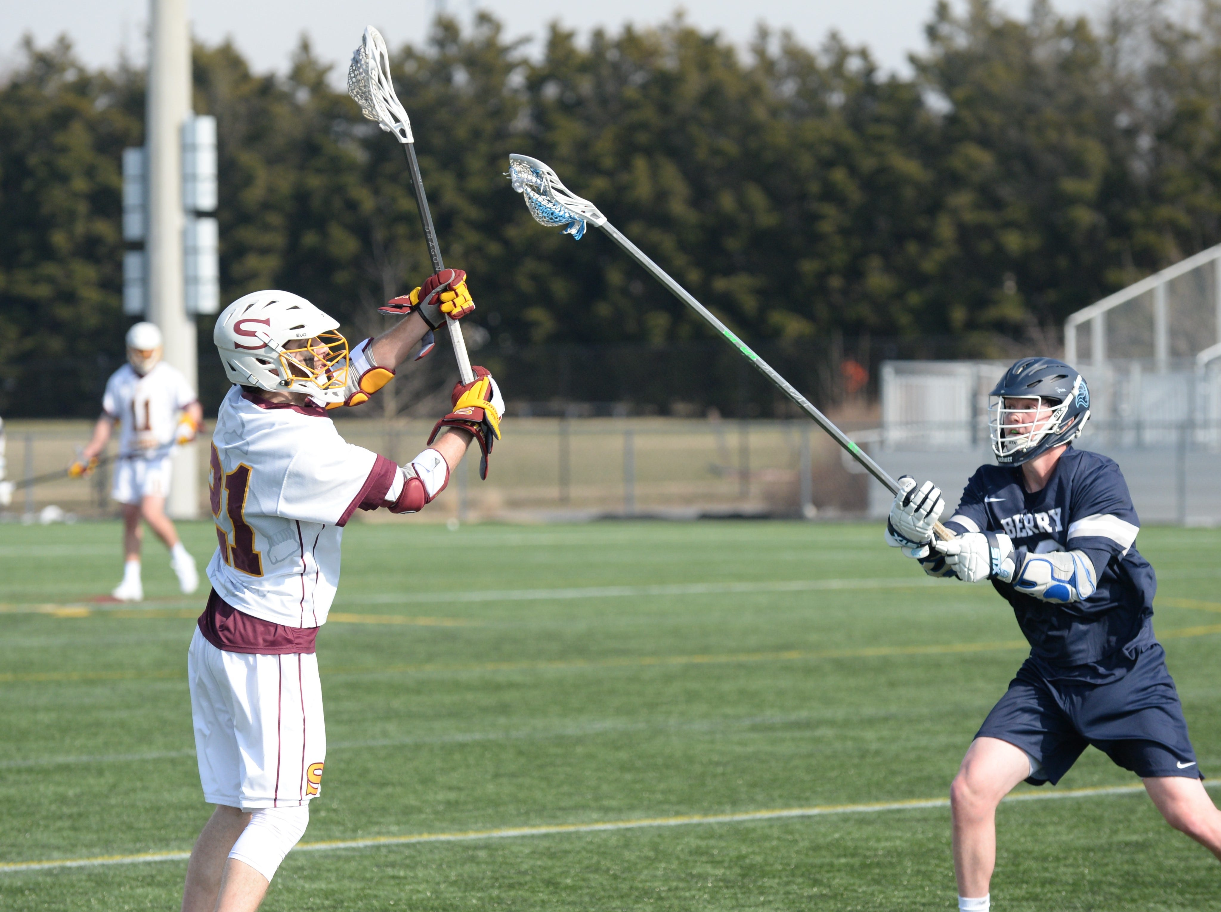 Salisbury University's Josh Melton passes against a Berry College defender on Sunday, Feb. 3, 2019.