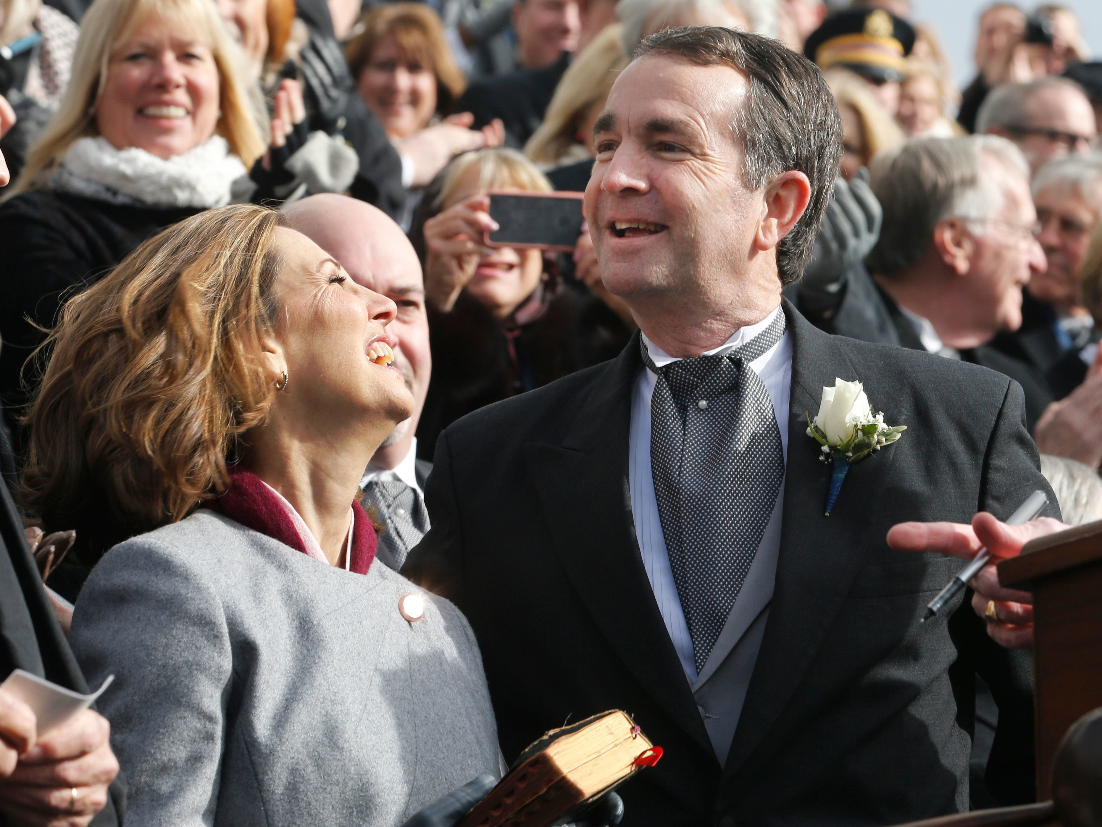 Gov. Ralph Northam, right, and his wife, Pam, smile after he took the oath of office during inaugural ceremonies at the Capitol in Richmond on Saturday, Jan. 13, 2018.