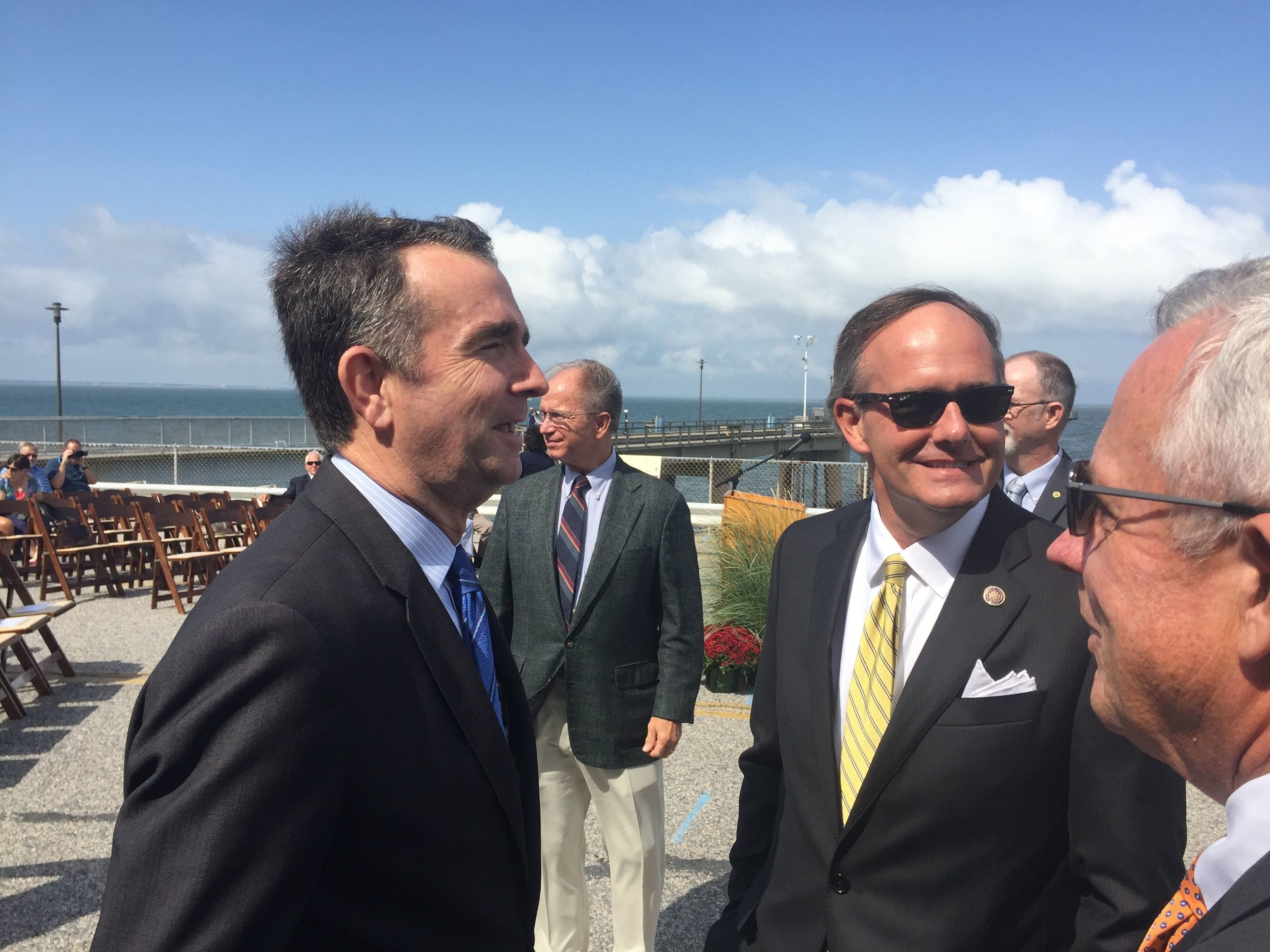 Lt. Gov. Ralph Northam, left, chats with Sen. Lynwood Lewis before a groundbreaking ceremony for the parallel tunnel project on the Chesapeake Bay Bridge-Tunnel on  Sept. 18, 2017.