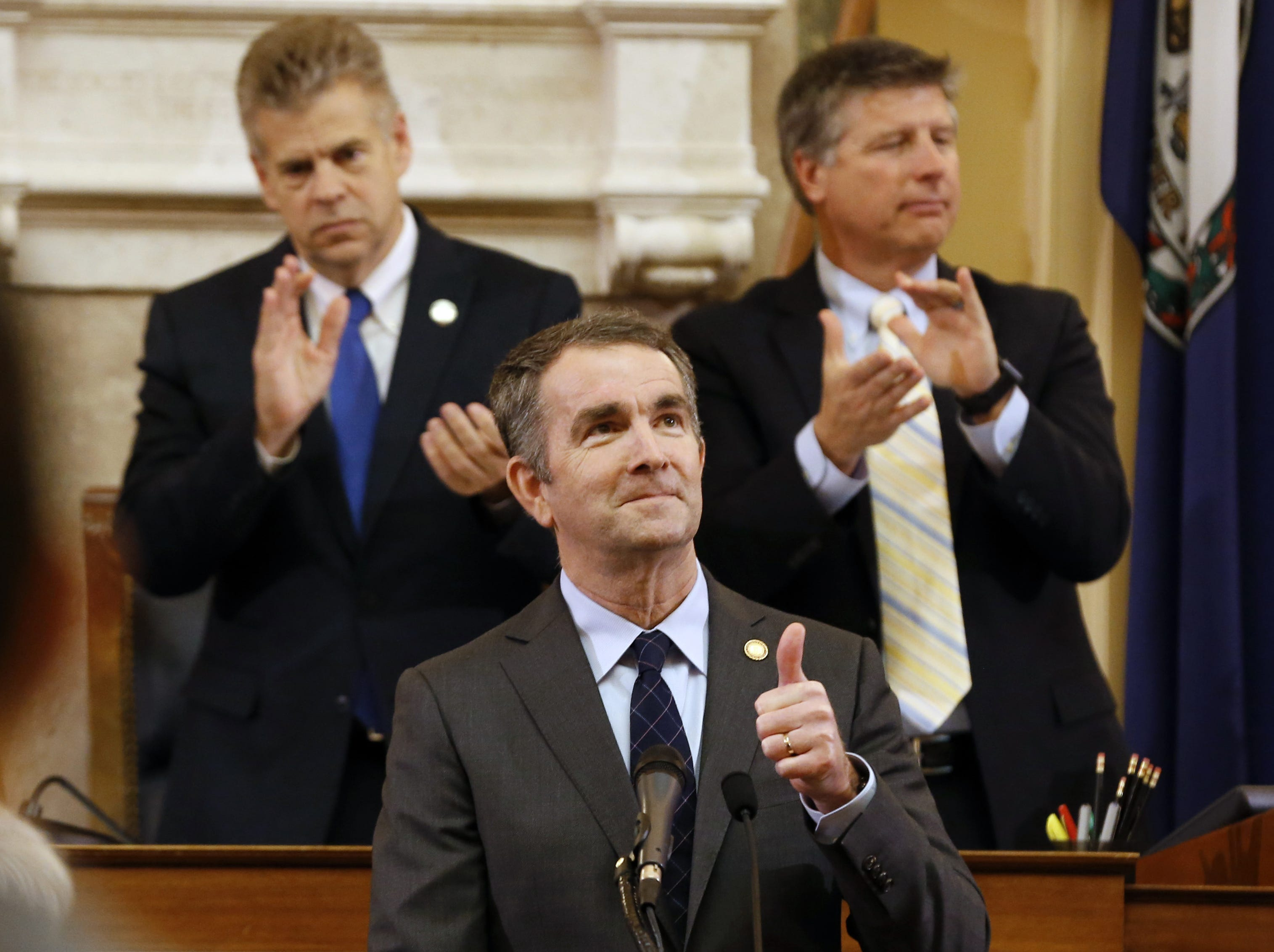 Virginia Gov. Ralph Northam, center, gives a thumbs-up as he delivers his State of the Commonwealth address during a joint session of the Virginia Legislature in the House chambers at the Capitol in Richmond on Jan. 9, 2019.