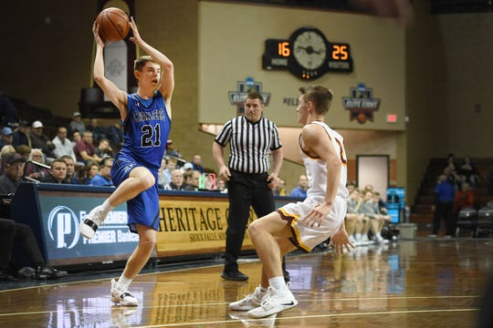 St. Thomas More's Caden Casey goes against Harrisburg defense during the game Saturday, Feb. 2, at the Pentagon High School Boys Basketball Classic in Sioux Falls.