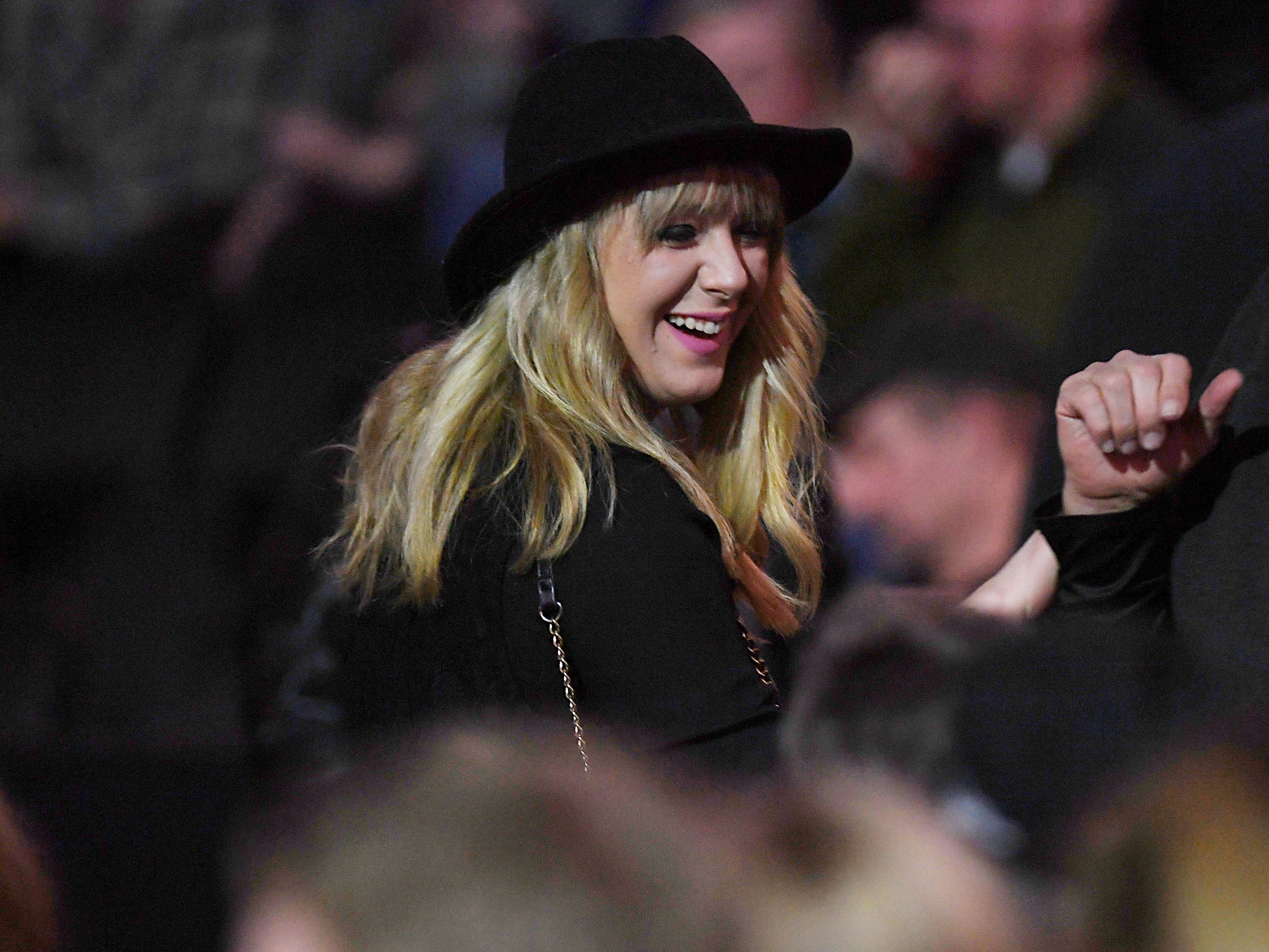 A Fleetwood Mac fan is complimented for her hat during the concert at the Denny Sanford Premier Center Saturday, Feb. 2, in Sioux Falls. The new lineup included Mick Fleetwood, John McVie, Stevie Nicks, Christine McVie, Mike Campbell and Neil Finn.