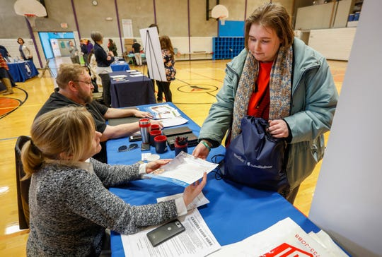 Kelsey Cotten, right, talks with Job Corps Outreach and Admissions Counselor Emily Nelms during the Point in Time homeless county at the YMCA on Thursday, Jan. 31, 2019. The results of the Homeless Youth Report will be released Friday.