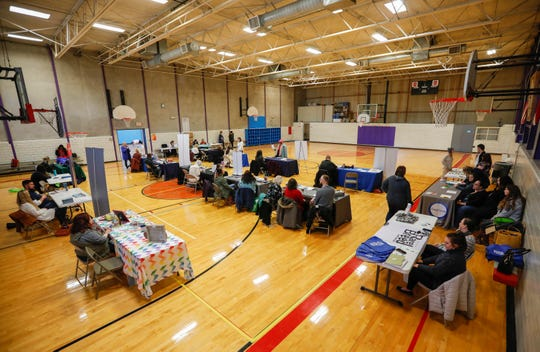 Different services wait to provide information during the Point in Time homeless count at the YMCA on Thursday, Jan. 31, 2019.