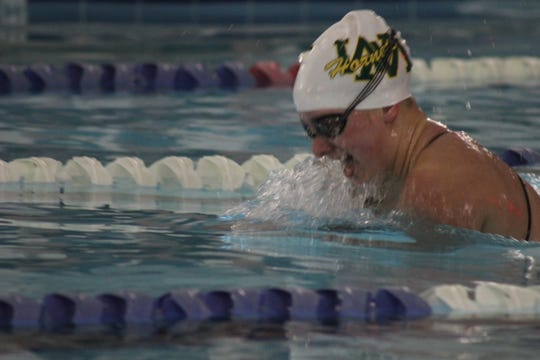 Wilson Memorial's Cameron Murie swam the beast stroke portion of the 200-medley relay Saturday at the Region 2B swim championships.