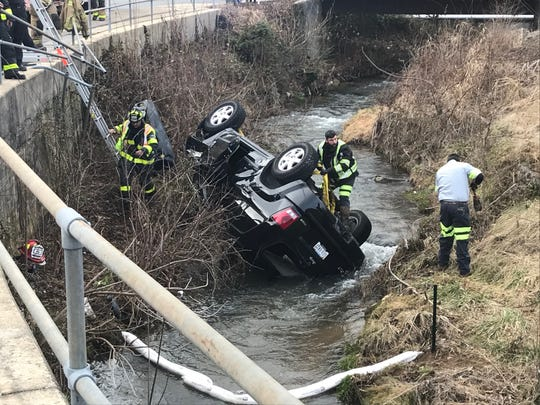 A man was injured Sunday afternoon in Staunton after a car went through a handrail and landed in Lewis Creek, police said.