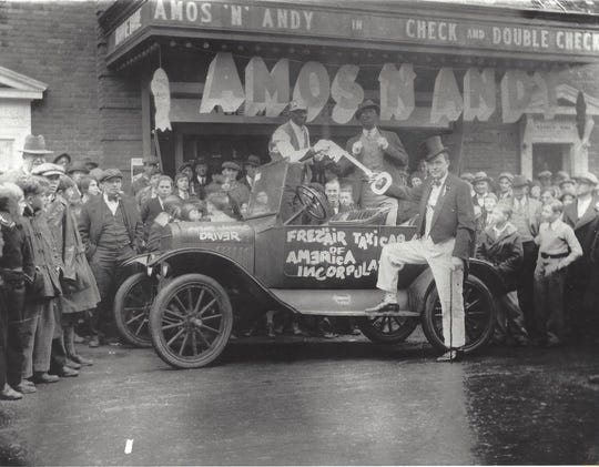 Radio stars Amos & Andy (who were white men in blackface) receive the key to the city in front of Waynesboro's Wayne Theater, early 1930s.