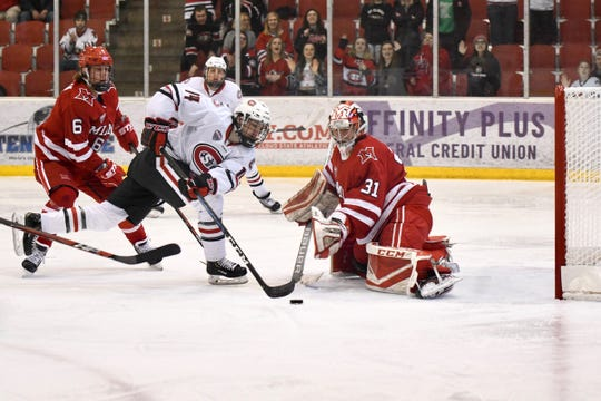 St. Cloud State senior Patrick Newell (#14) puts a move on Miami University's goalie in Saturday's game at the Herb Brooks National Hockey Center.