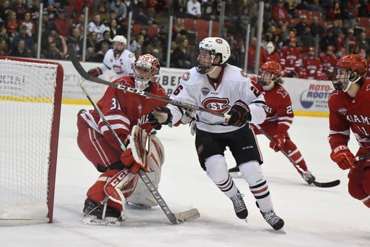 St. Cloud State sophomore Easton Brodzinski (#26) looks to play the puck behind the net in Saturday's NCHC battle against Miami University at the Herb Brooks National Hockey Center.