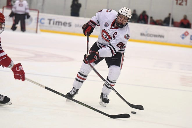 St. Cloud State senior Jimmy Schuldt (#22) makes a pass in the offensive zone  on Saturday against Miami University at the Herb Brooks National Hockey Center.