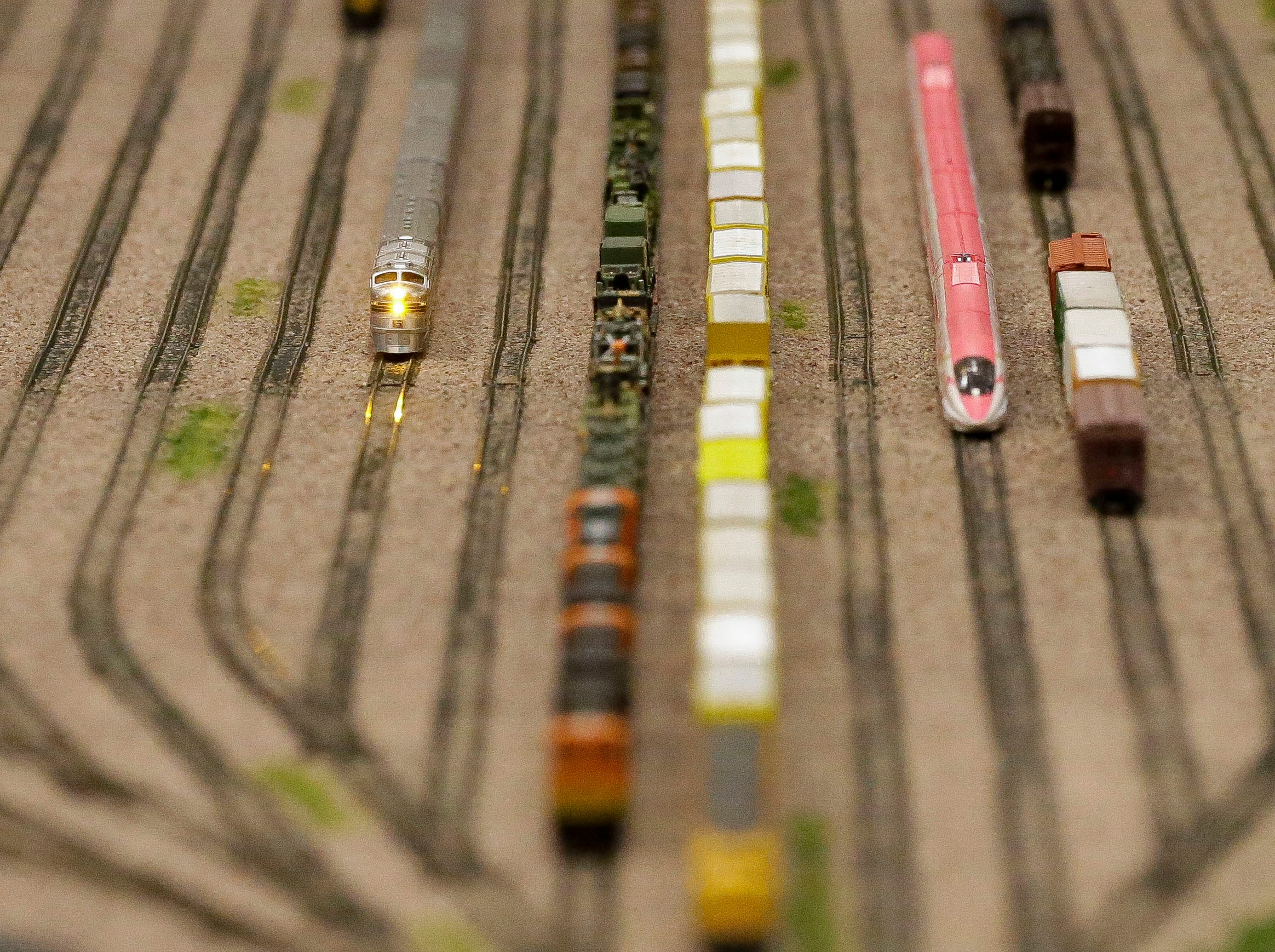 Model trains run along a diorama on Sunday, February 3, 2019, during the Arctic Run Model Railroad Show at the Holiday Inn Convention Center in Stevens Point, Wis.Tork Mason/USA TODAY NETWORK-Wisconsin
