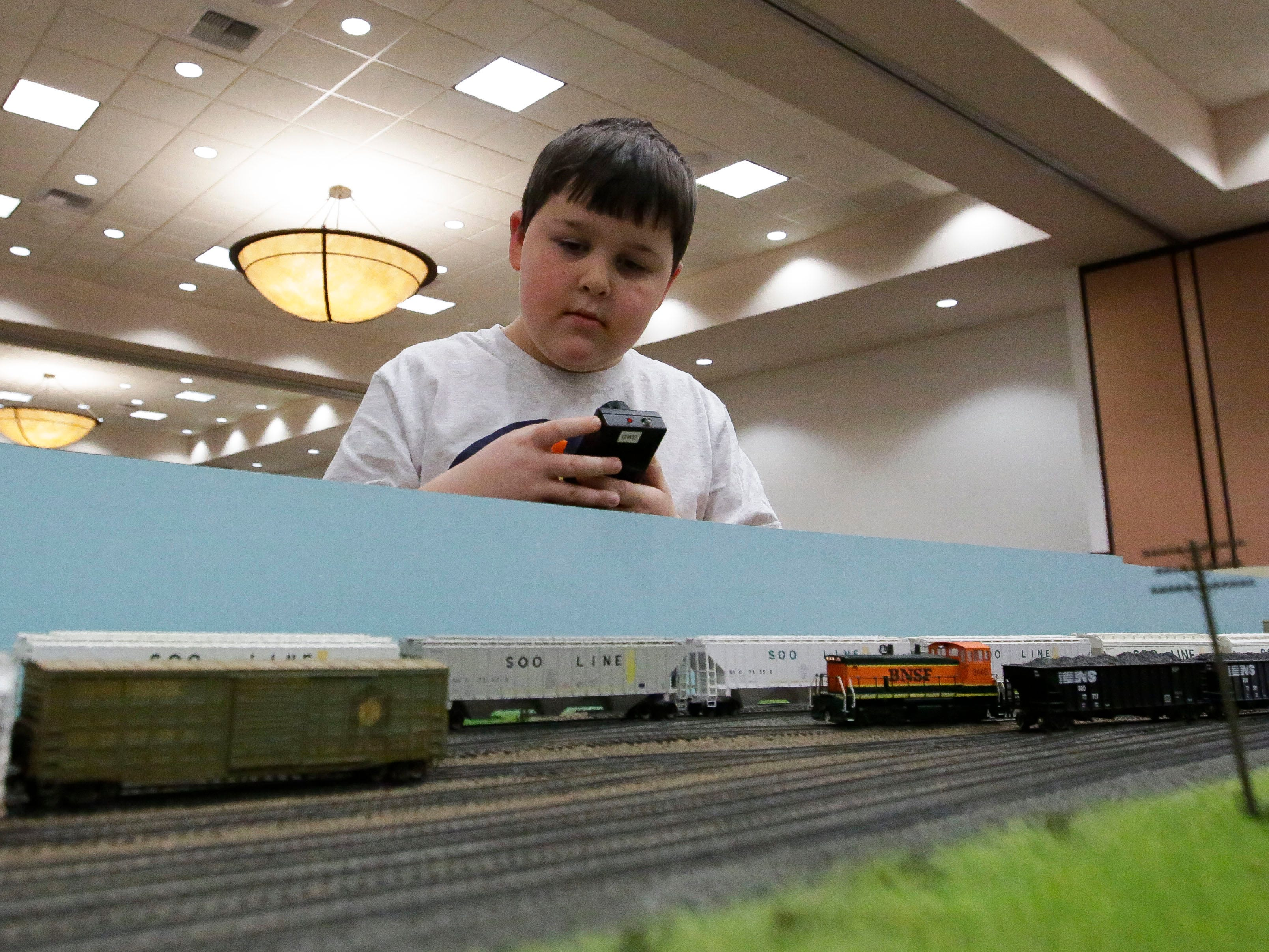 Isaac Drewiske controls a model train on Sunday, February 3, 2019, during the Arctic Run Model Railroad Show at the Holiday Inn Convention Center in Stevens Point, Wis.Tork Mason/USA TODAY NETWORK-Wisconsin