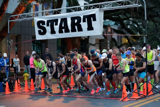 Runners take their marks at the start line of the Tallahassee Marathon, Sunday morning, Feb. 3, 2019.