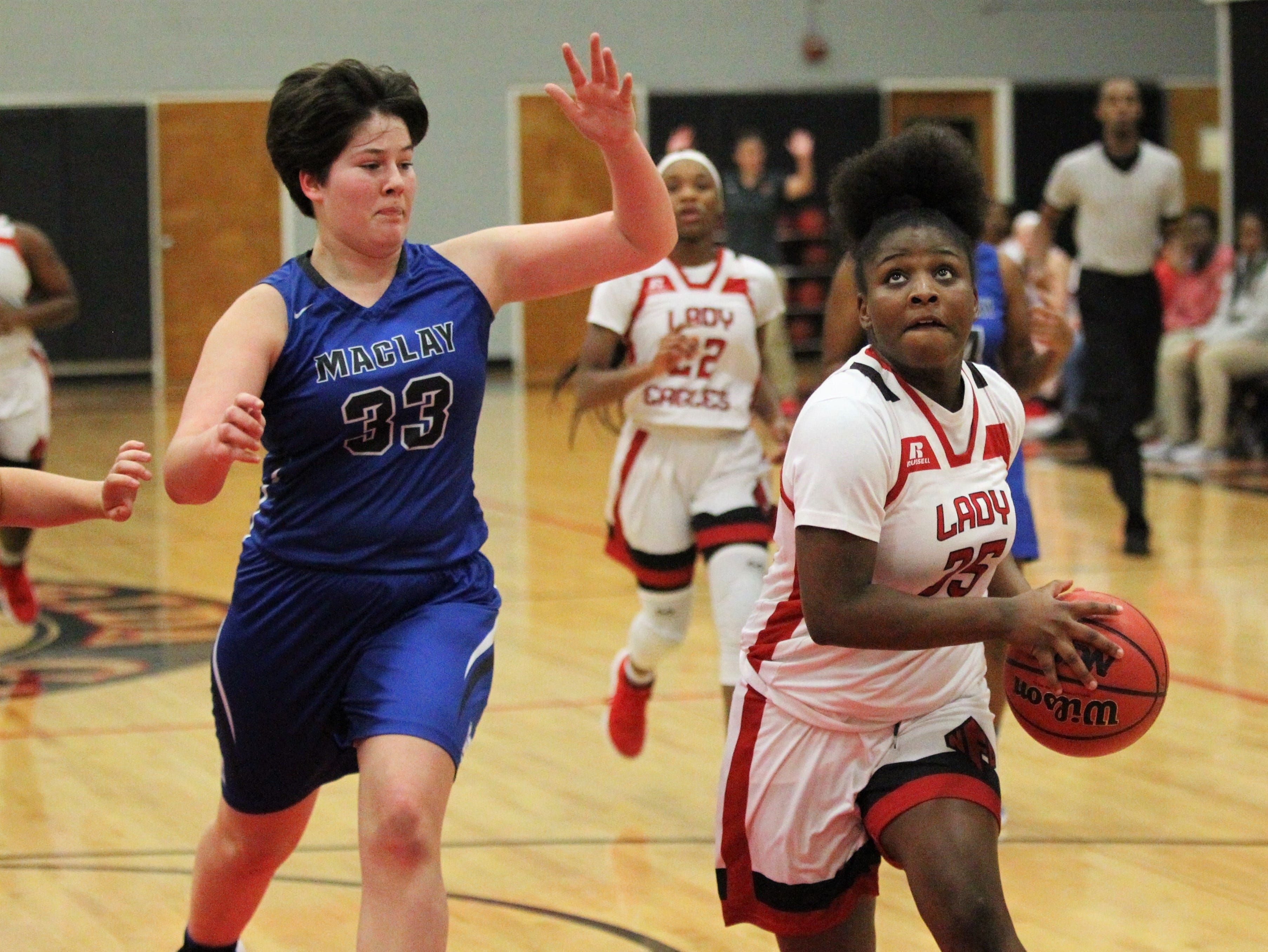 NFC freshman Alexis Howard drives to the basket as NFC's girls basketball team beat Maclay 72-56 on Jan. 31, 2019.