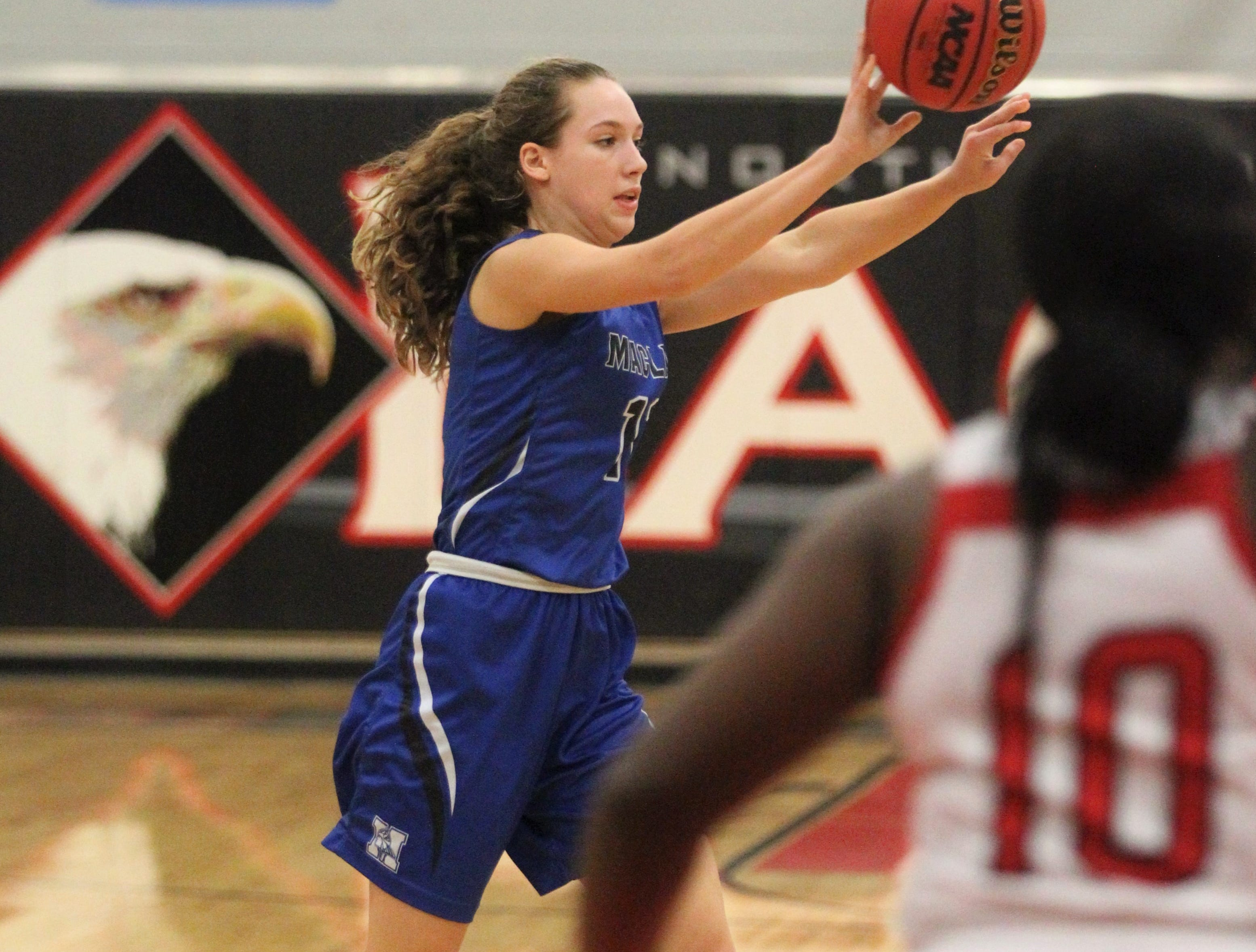 Maclay senior Jane-Kathryn Whittington makes a pass on the perimeter as NFC's girls basketball team beat Maclay 72-56 on Jan. 31, 2019.
