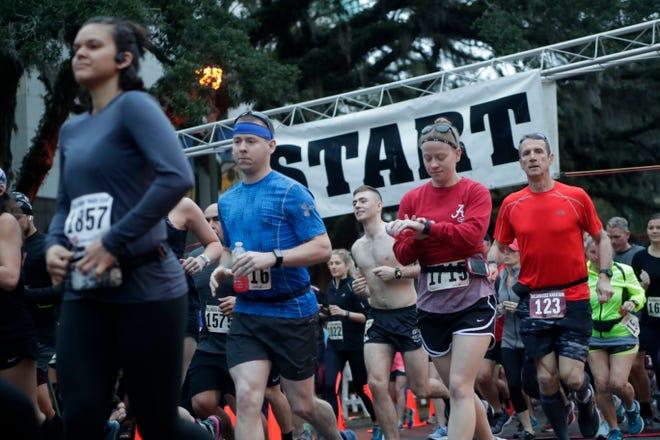 Runners cross the start line of the Tallahassee Marathon in 2019. This year's marathon will be Sunday, Feb. 2.