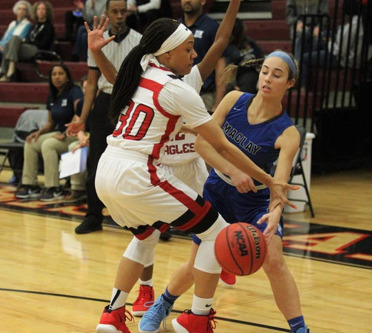 NFC's Caylan Jones tries to steal a backcourt pass from Maclay's Marie Shapley as NFC's girls basketball team beat Maclay 72-56 on Jan. 31, 2019.