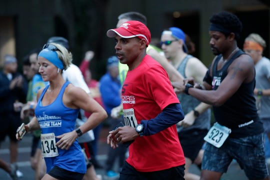 Meb Keflezighi, an Olympic medalist, runs among  the hundreds of people who got up early to participate in the Tallahassee Marathon early Sunday morning, Feb. 3, 2019.