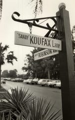 The intersection of Sandy Koufax Lane and Jackie Robinson Ave. in a picture taken in the 1980s.