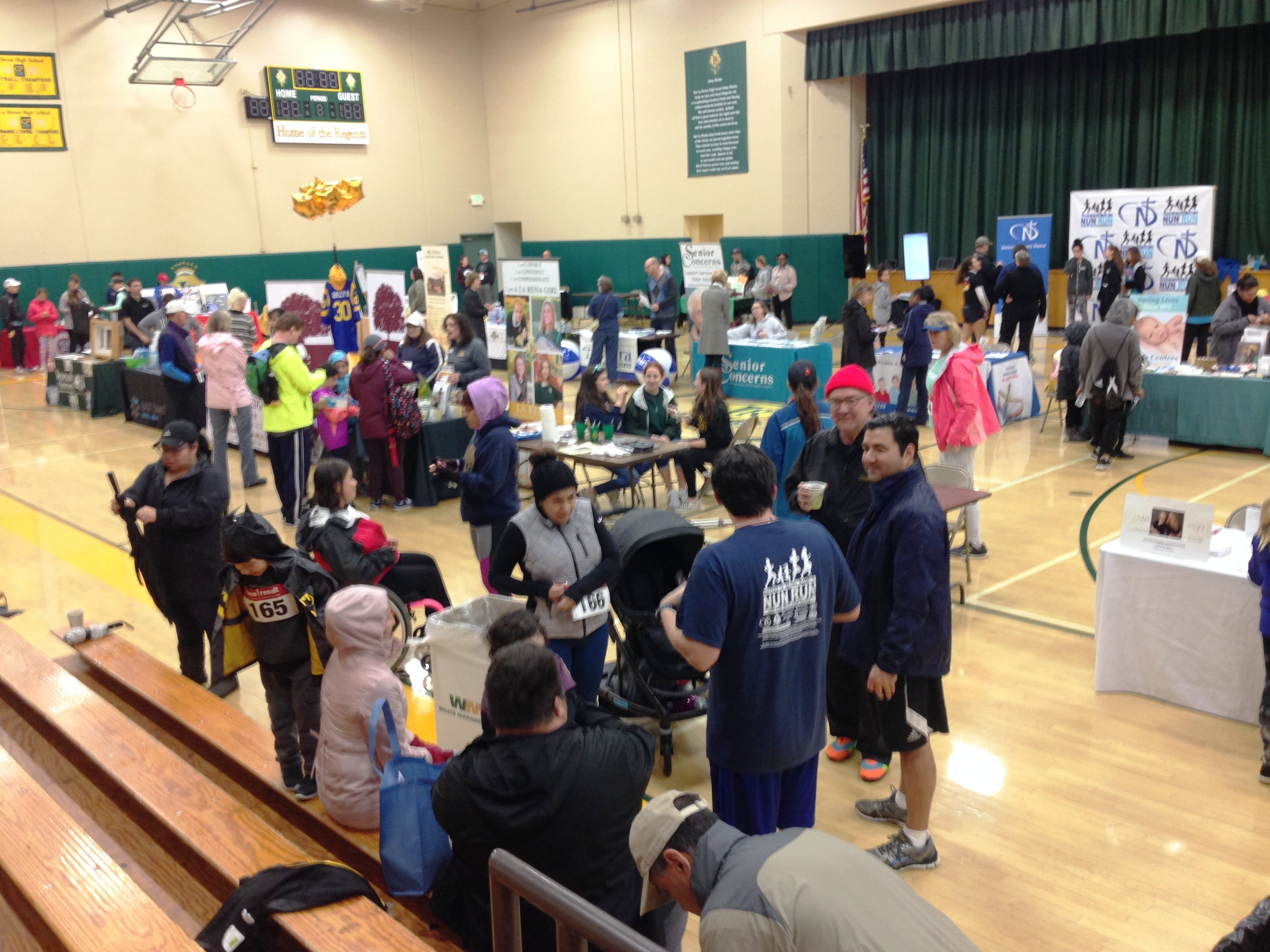 A community service fair inside the gymnasium was one of the event highlights during the fifth annual Sisters of Notre Dame Nun Run, presented by La Reina High School and Middle School in Thousand Oaks on Saturday.