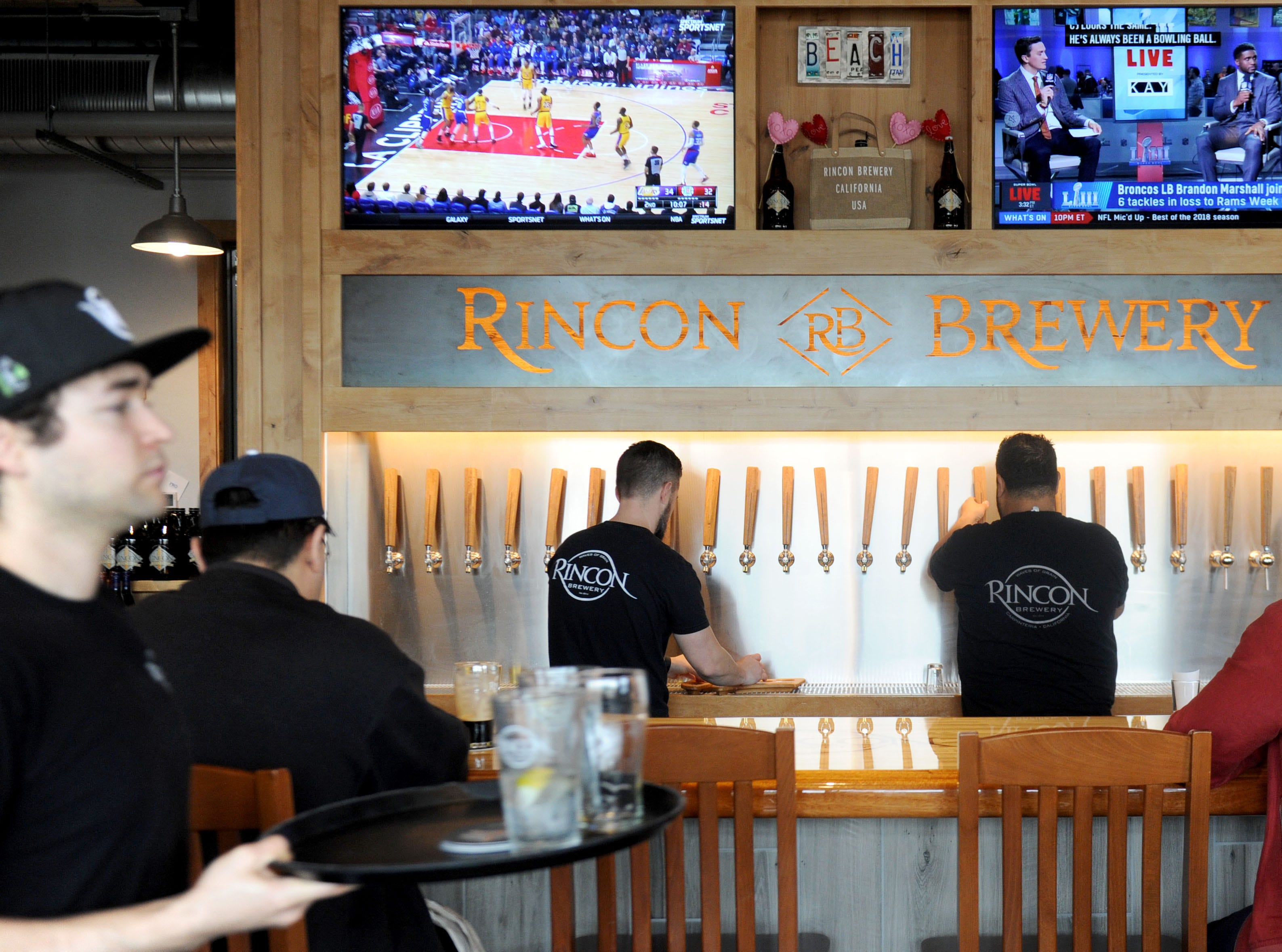 Customers sit at the beer bar at Rincon Brewery in Ventura. The brewery is the offspring of one in Carpinteria. Rincon Brewery is big with lots of high tables to sit at, a few normal height, large area of indoor seating, also seating on covered patio.