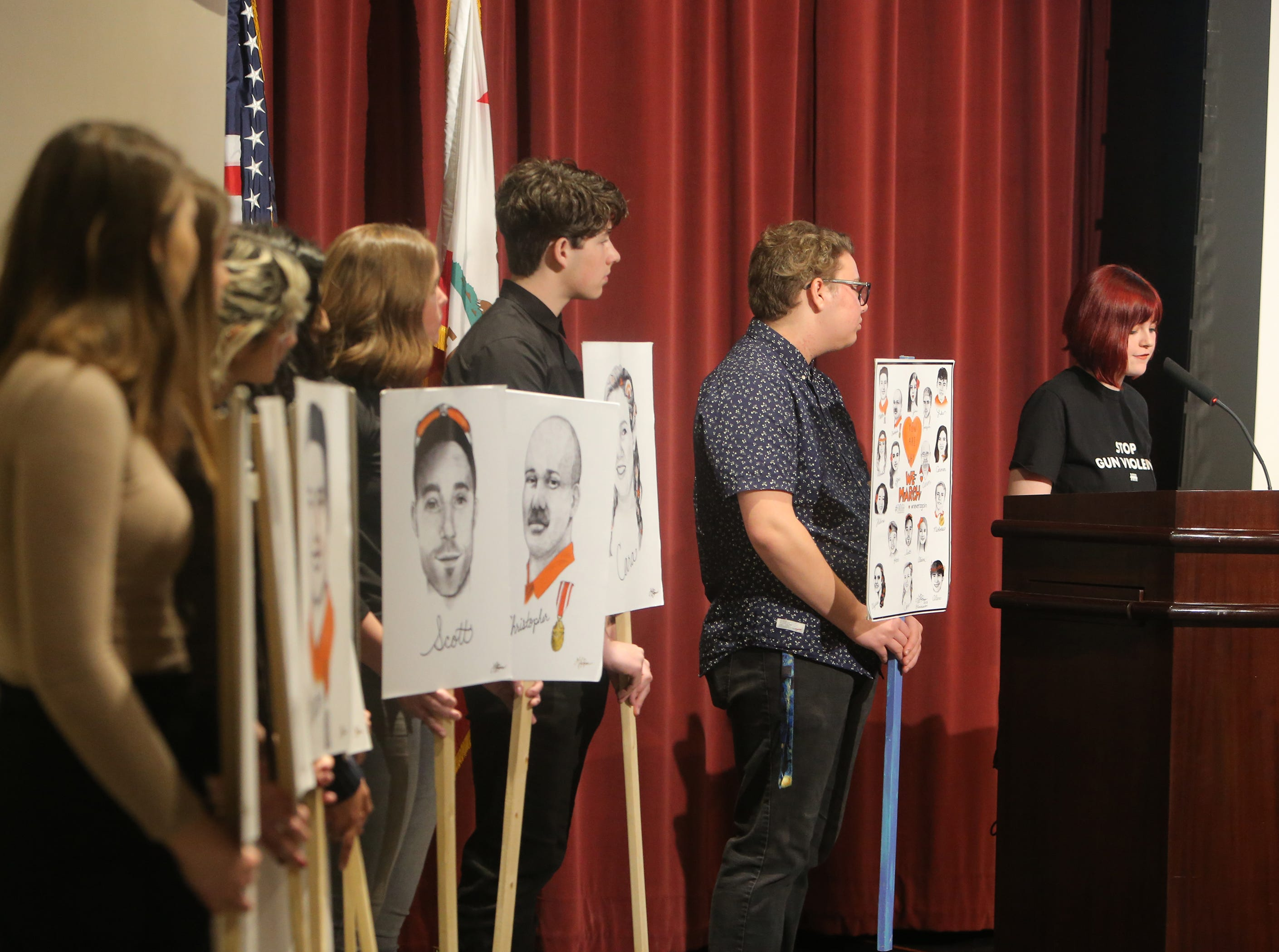 Gracie Pekrul, 17, of Simi Valley, speaks during a forum on gun violence held Sunday at Westlake High School in Thousand Oaks. Students from the Conejo Valley held up portraits Pekrul created portraying the victims of the school shooting in Parkland, Florida.