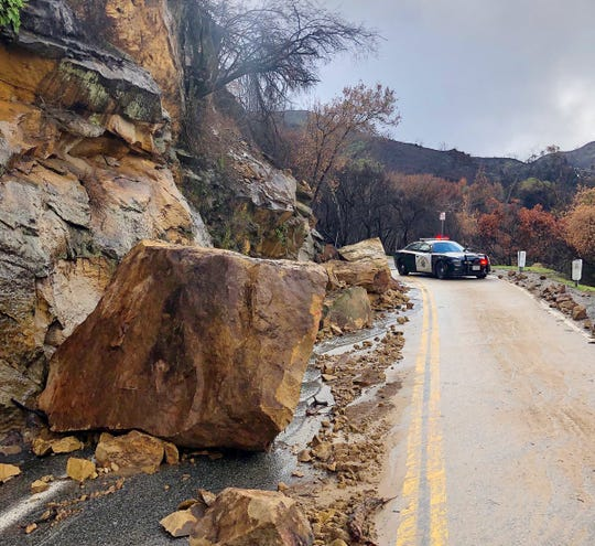 A section of Mulholland Highway, east of Kanan Road, was closed Sunday as officials worked to clear rocks and mud amid lingering rain showers.